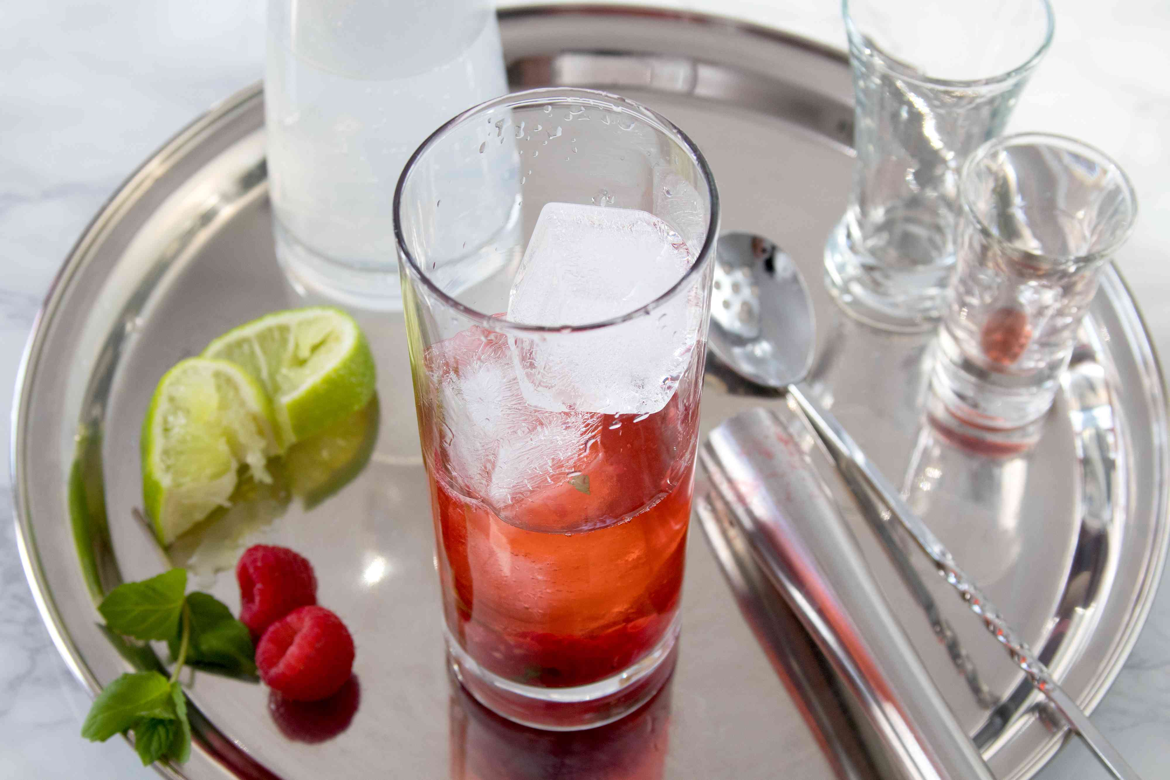 Rum and raspberry liqueur added to the glass