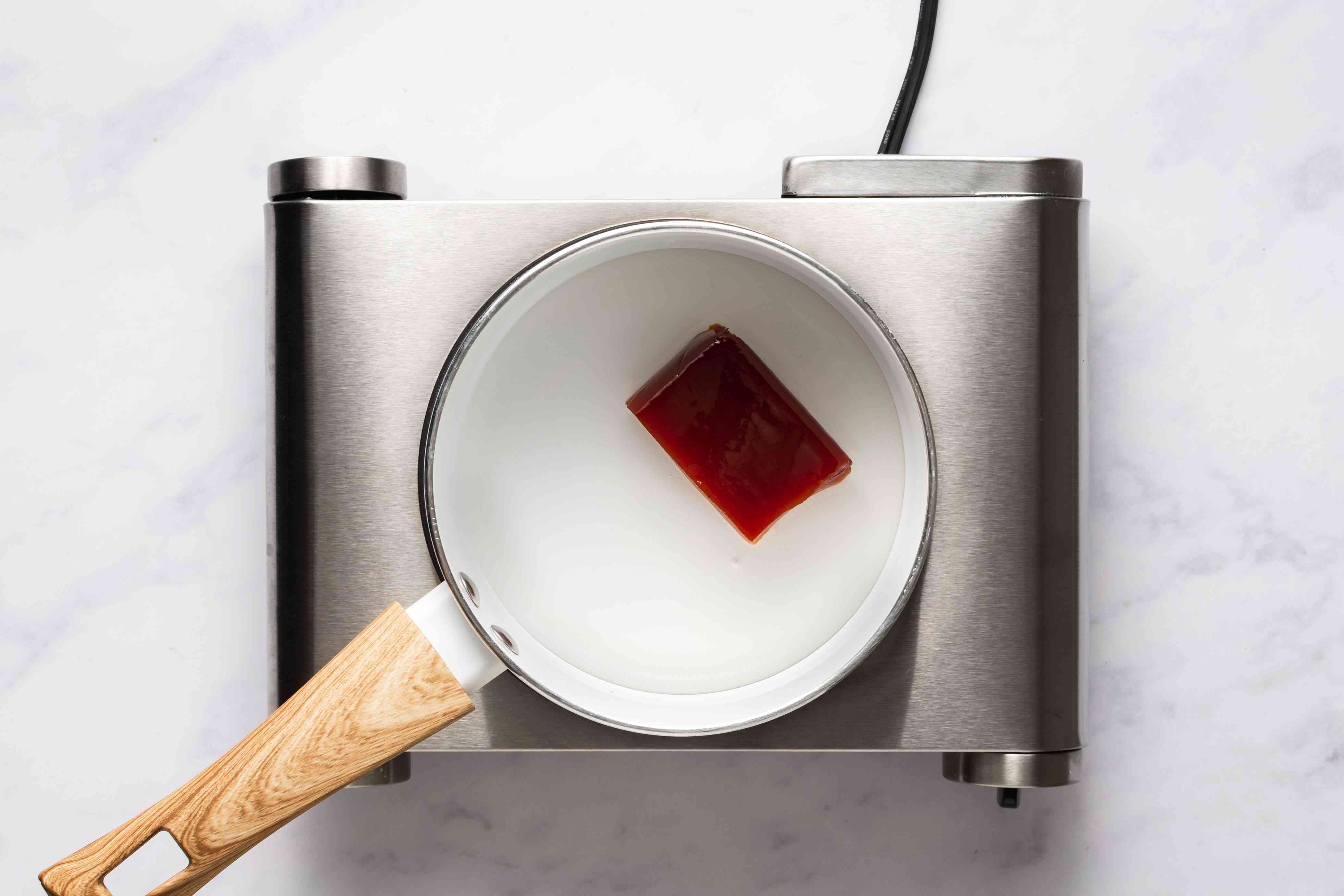 Combine the guava paste, vinegar and water in a saucepan