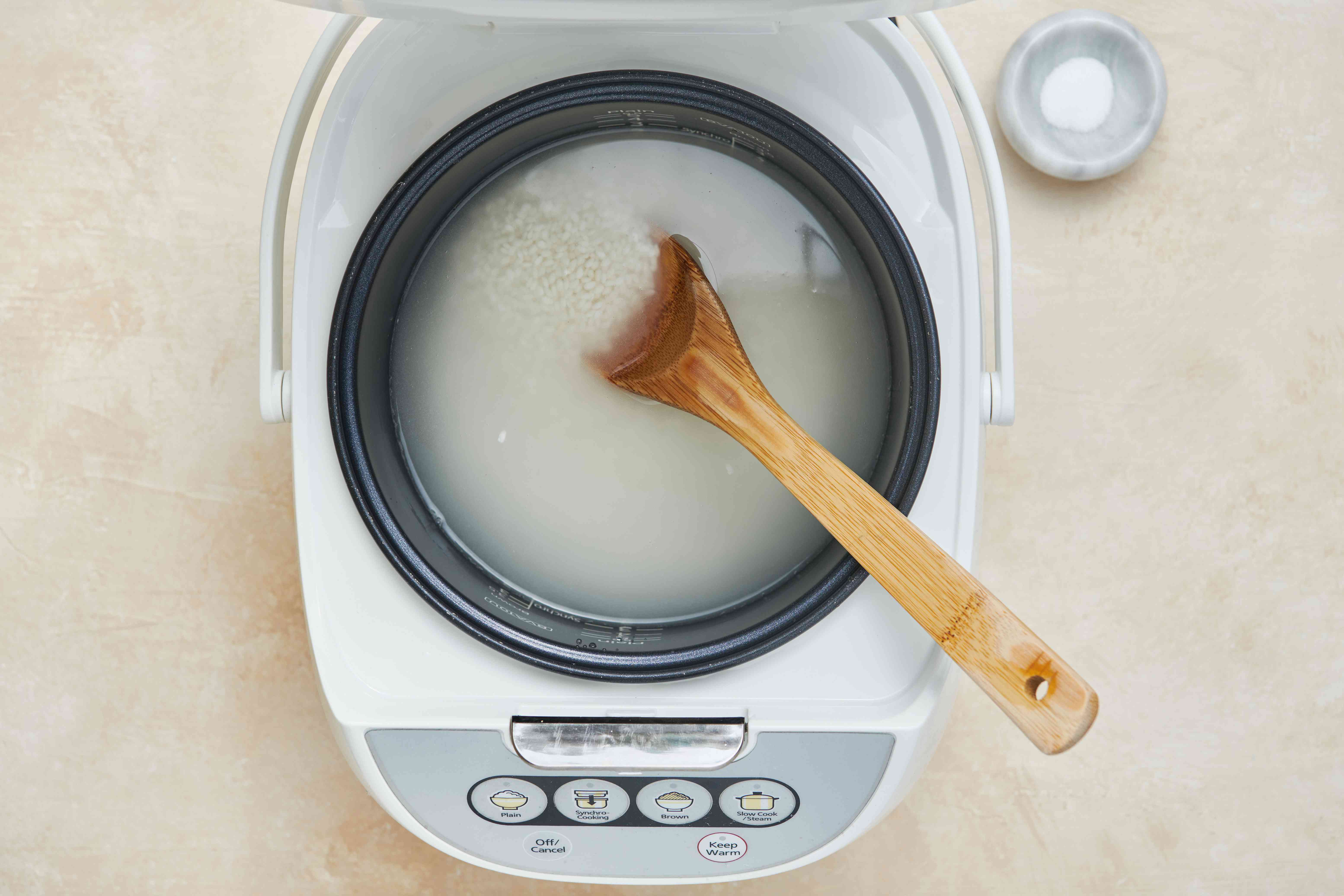 water and rice in a rice cooker