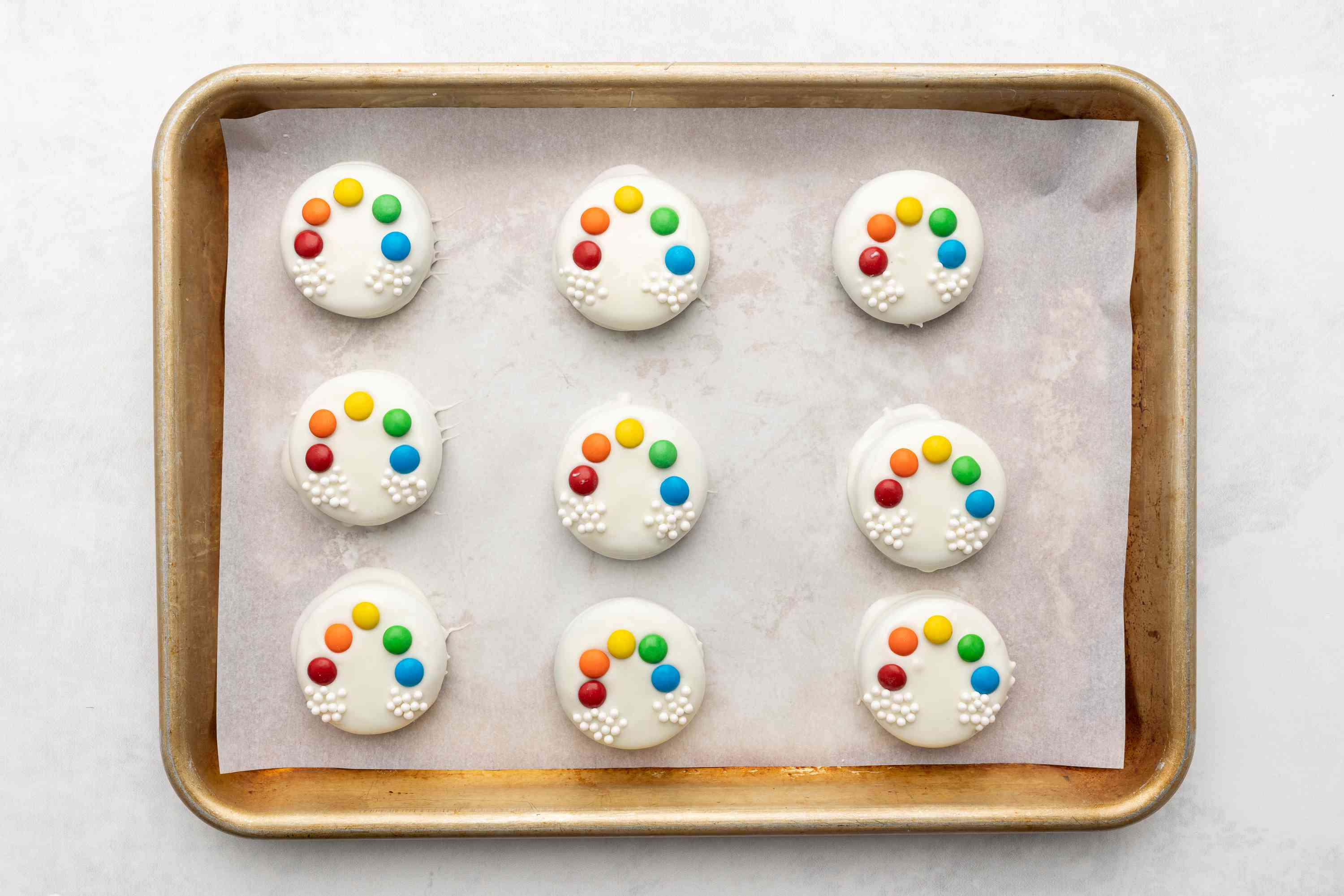 Rainbow Chocolate-Covered Cookies on a baking sheet