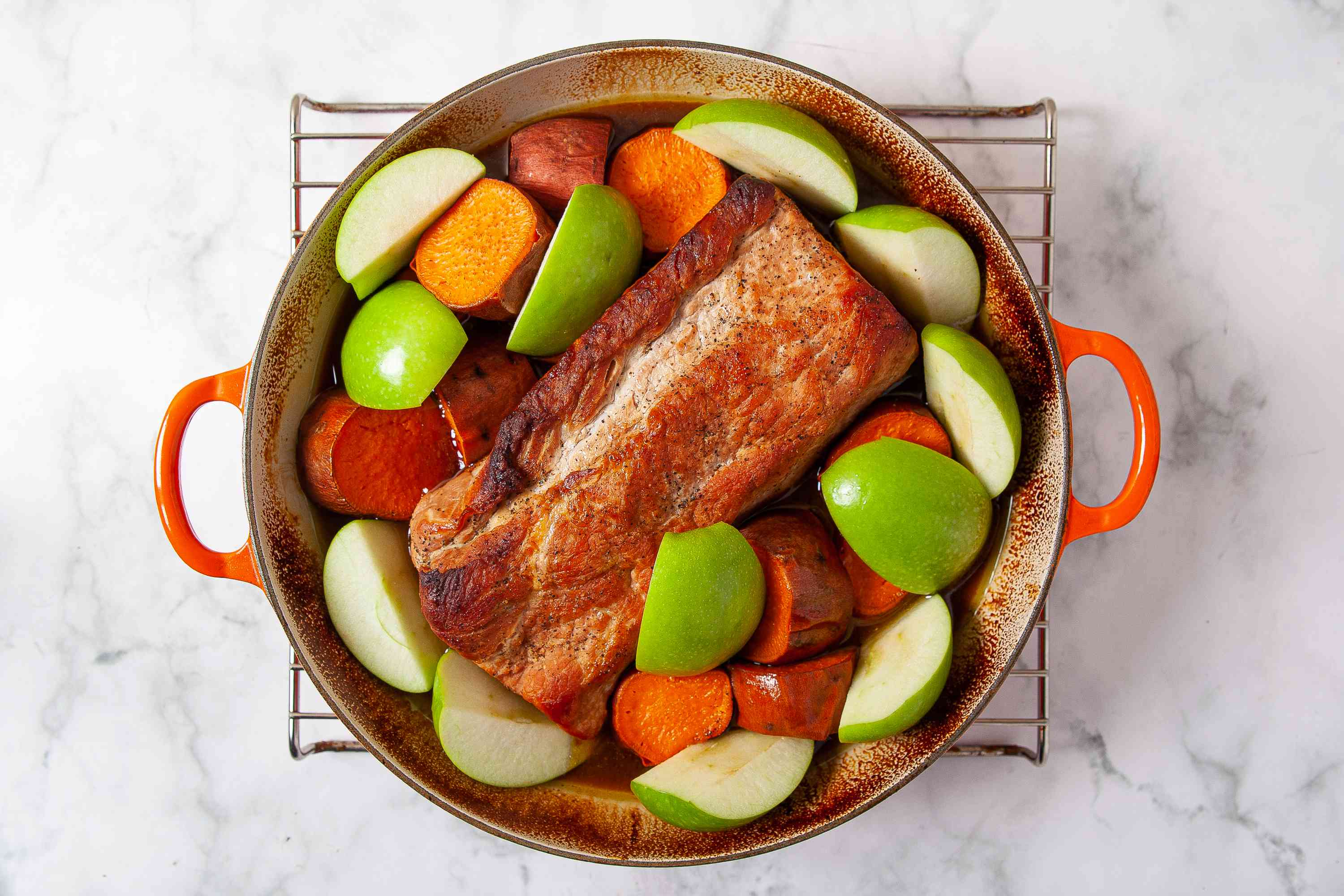 apples, sweet potatoes and pork loin in a Dutch oven