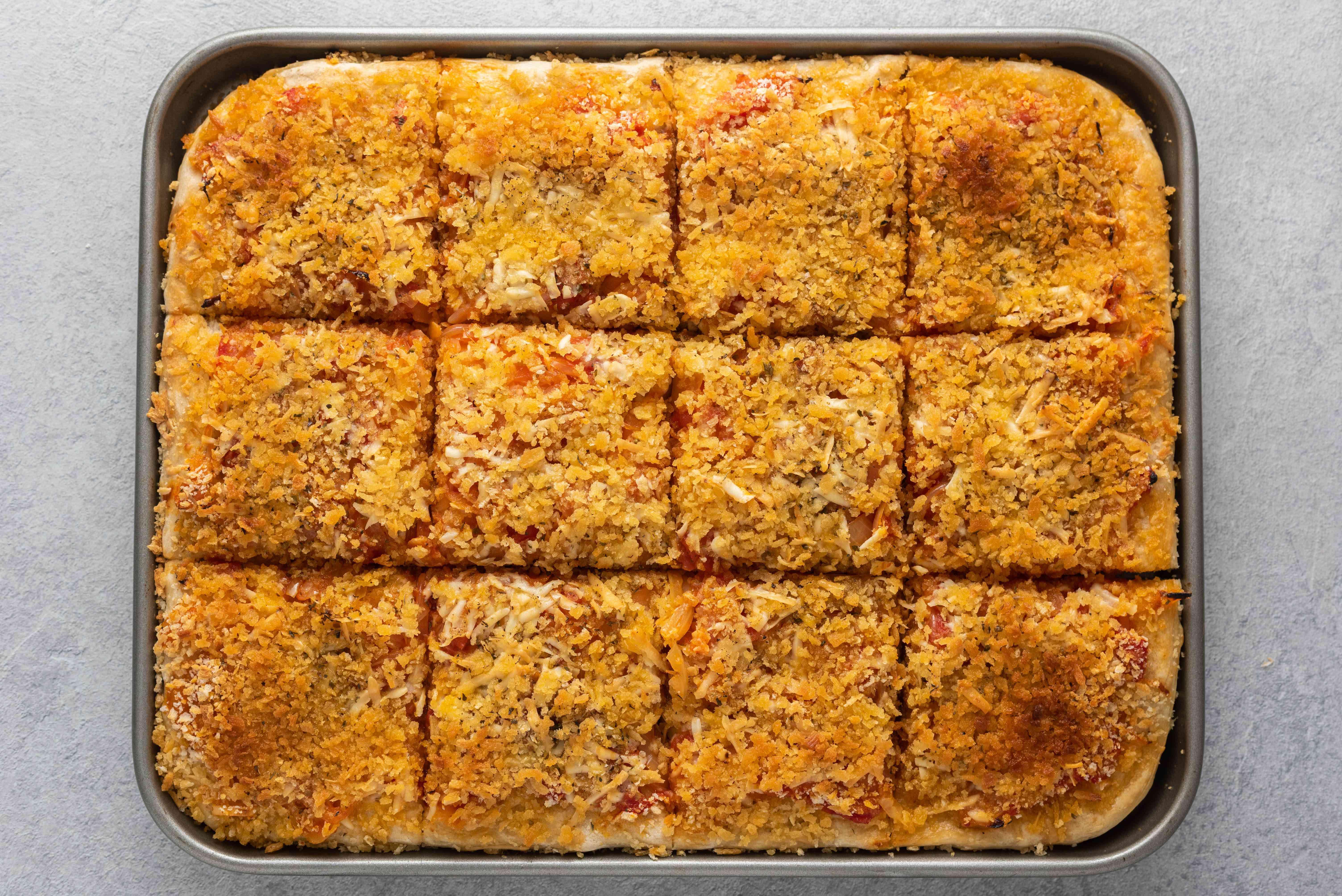 sliced Lo Sfincione, The Original Sicilian-Style Pizza on a baking sheet