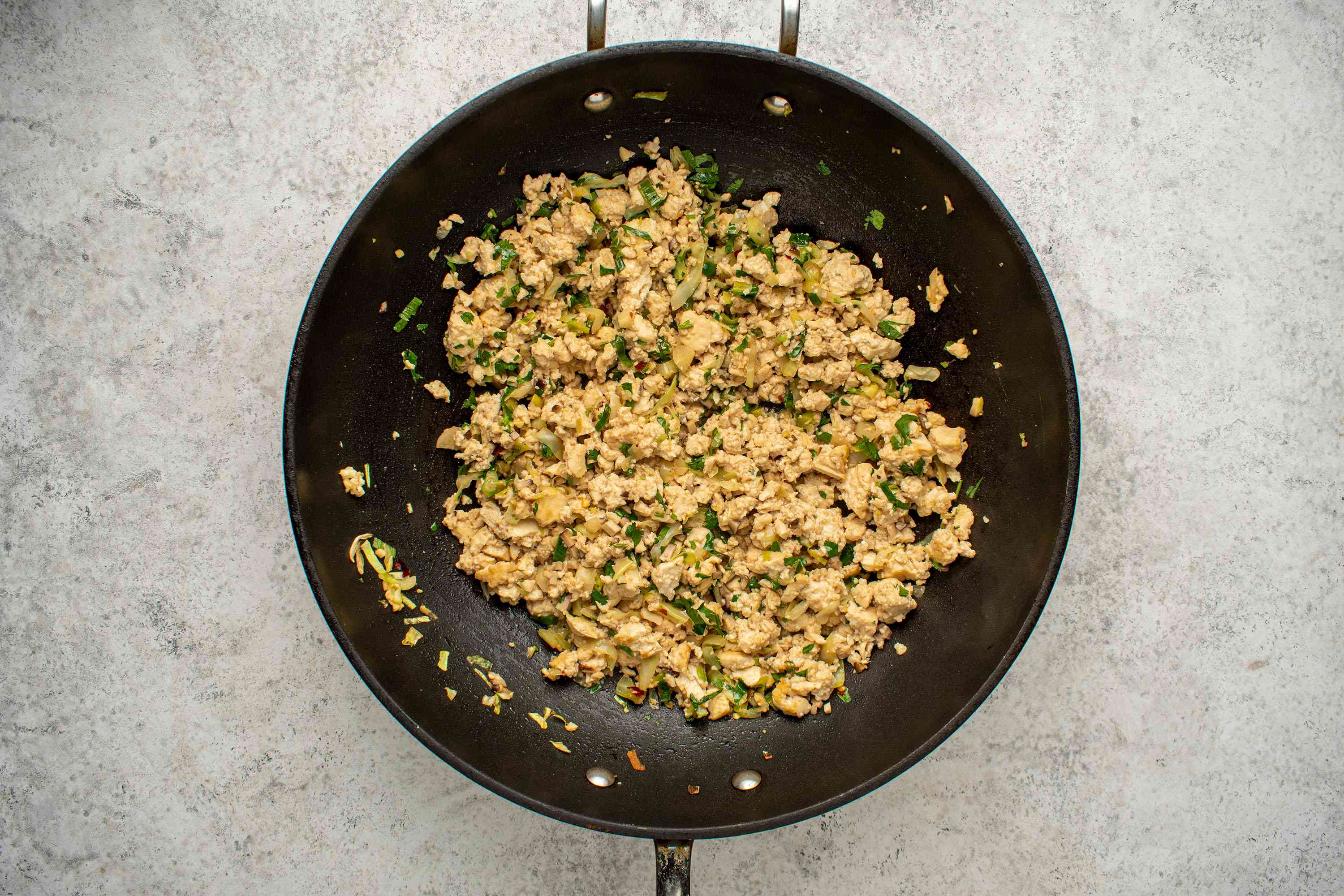 tofu mixture cooking in a wok