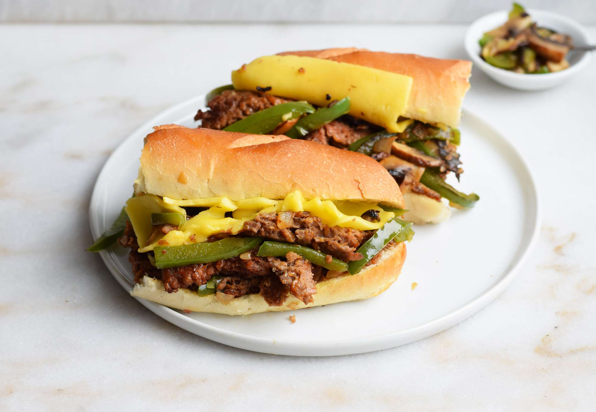 beyond meat Philly cheesesteak on a roll