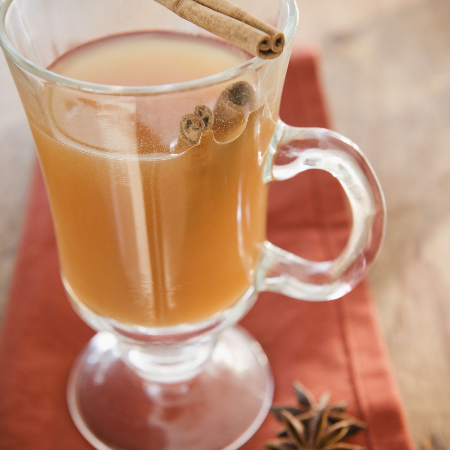 Close up of apple cider with cinnamon in glass