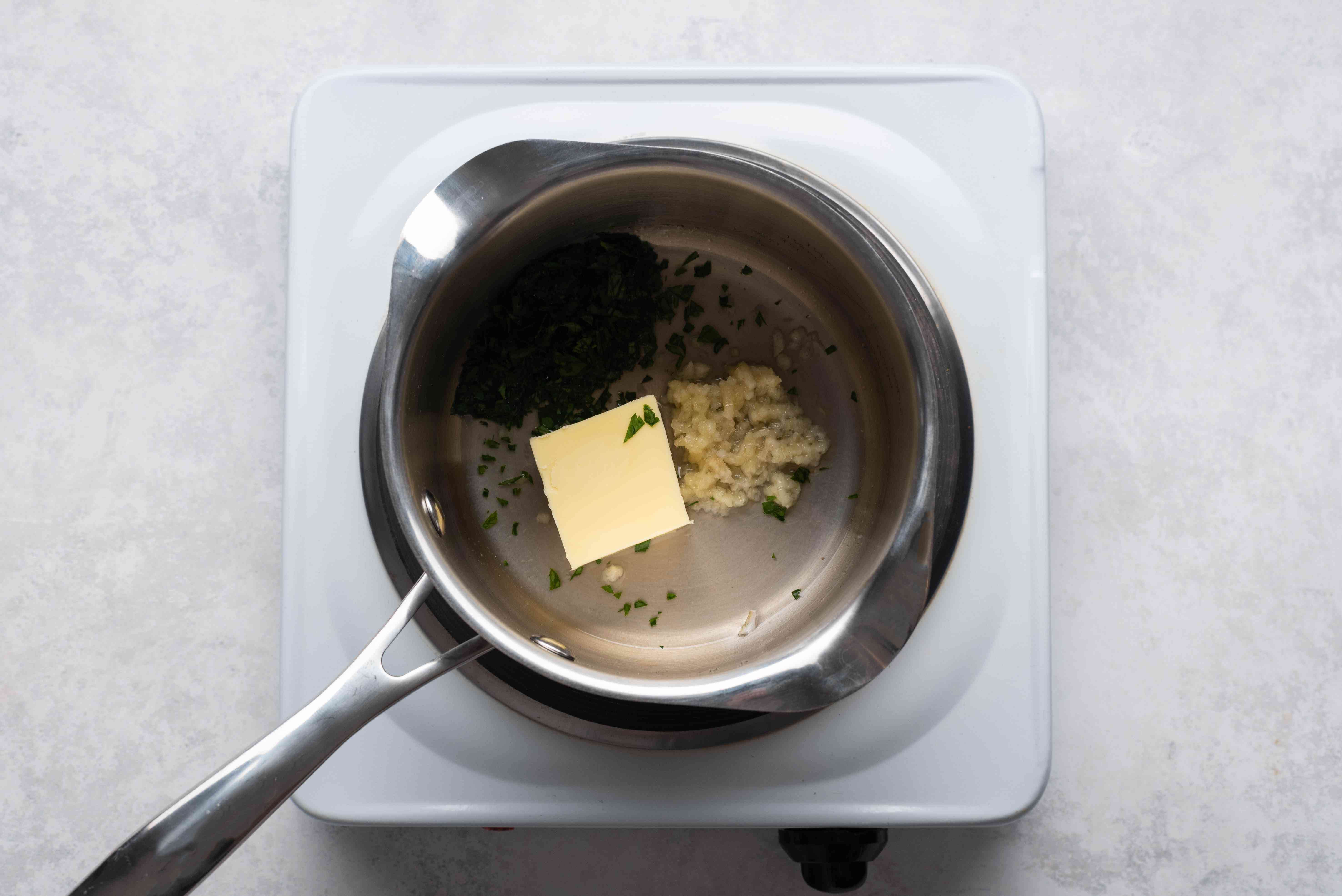 Combine the butter, lemon juice, garlic, and parsley in a small saucepan