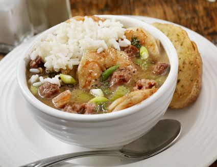 Gumbo and rice in a white bowl