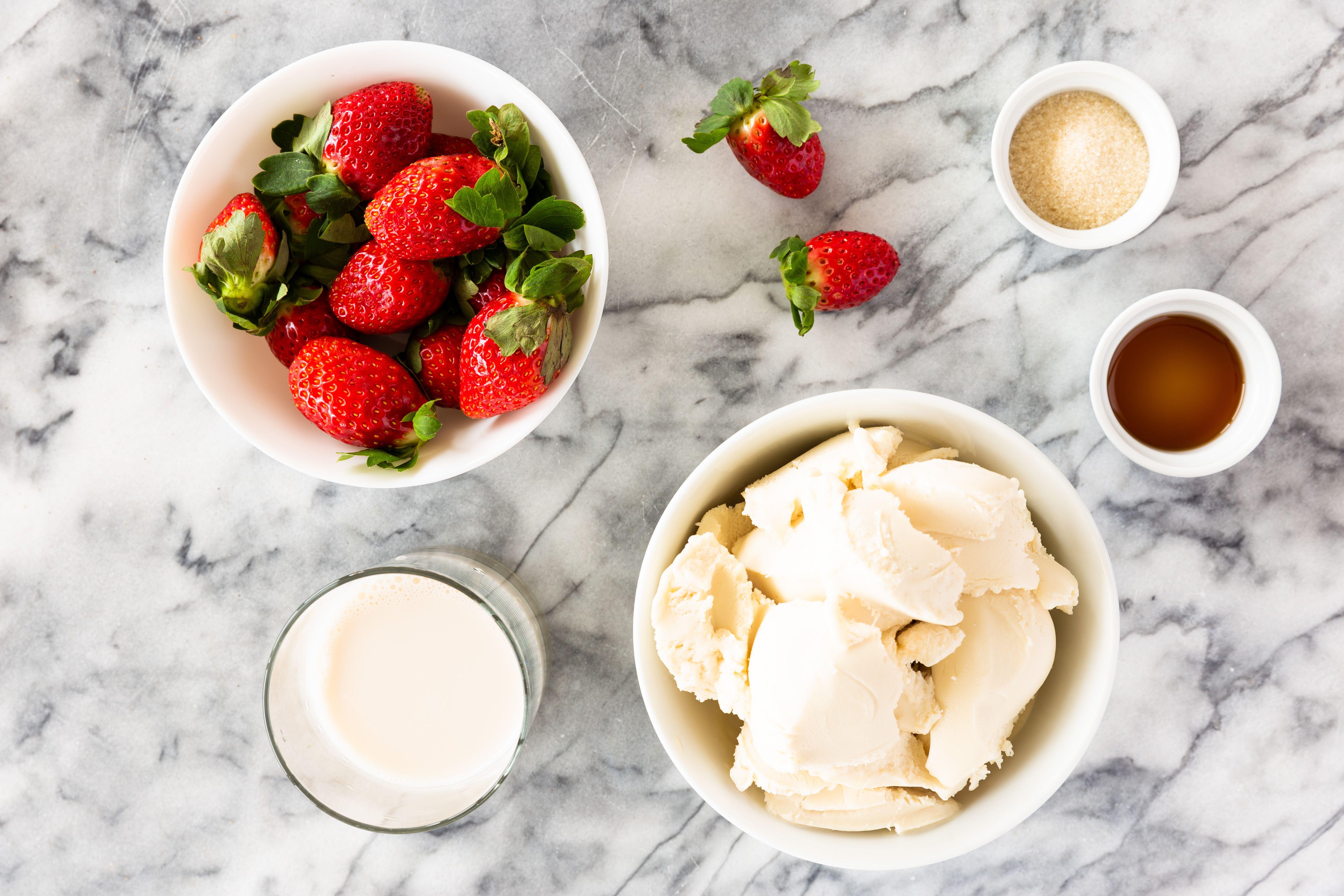 Ingredients for a strawberry milkshake