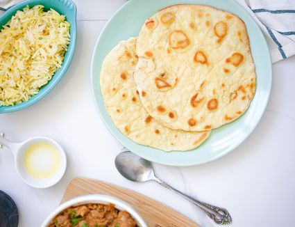 A meal with two pieces of roti flatbread on a plate