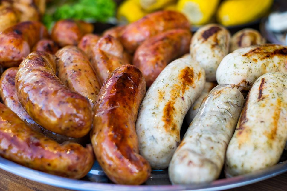 Fresh Sausage and Hot Dogs Grilling Outdoors on a Gas Barbecue Grill