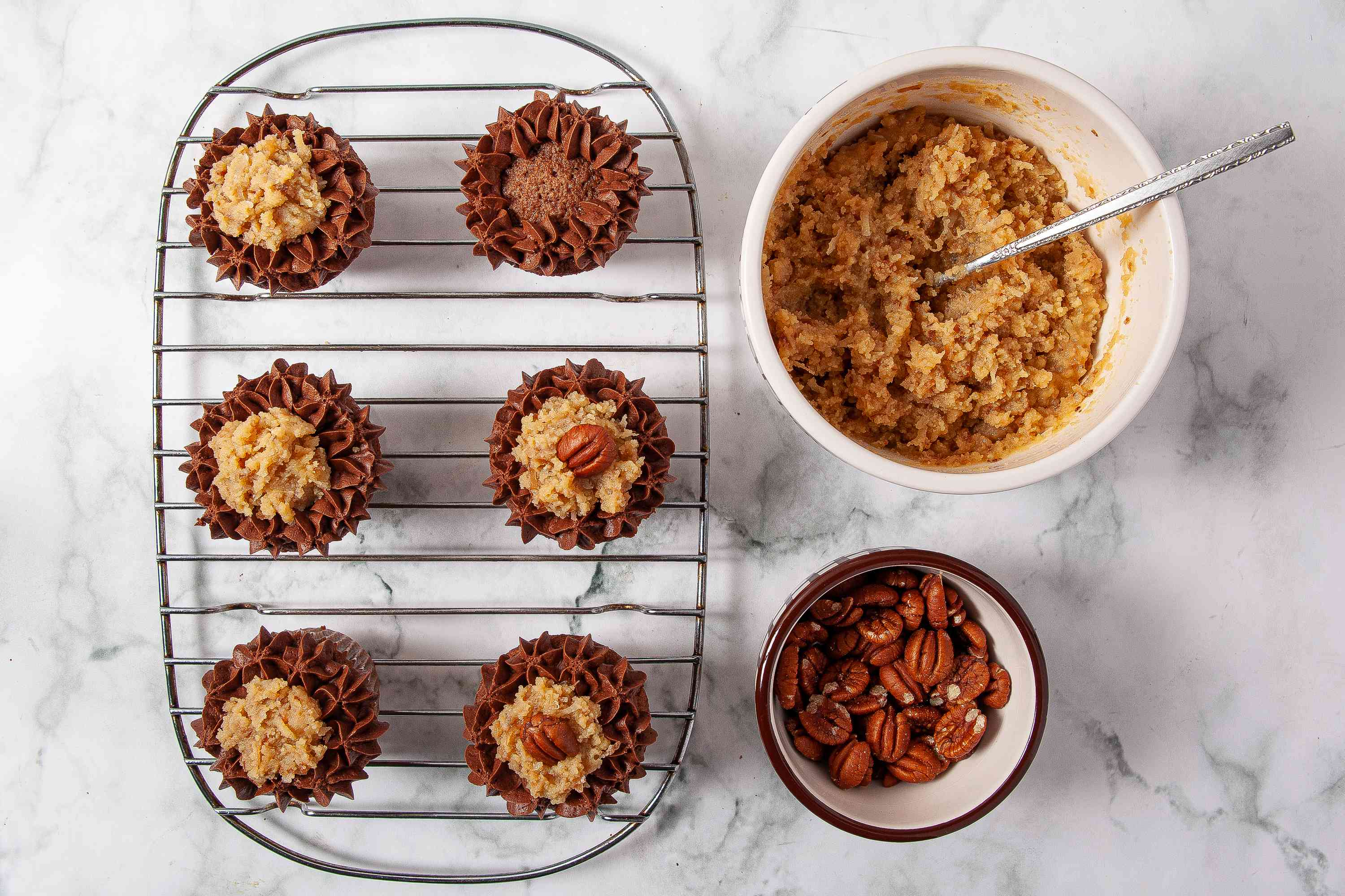 German Chocolate Cupcakes topped with coconut and pecan