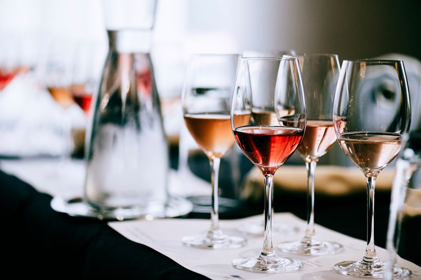 Glasses of Rosé wine lined up for a wine tasting event
