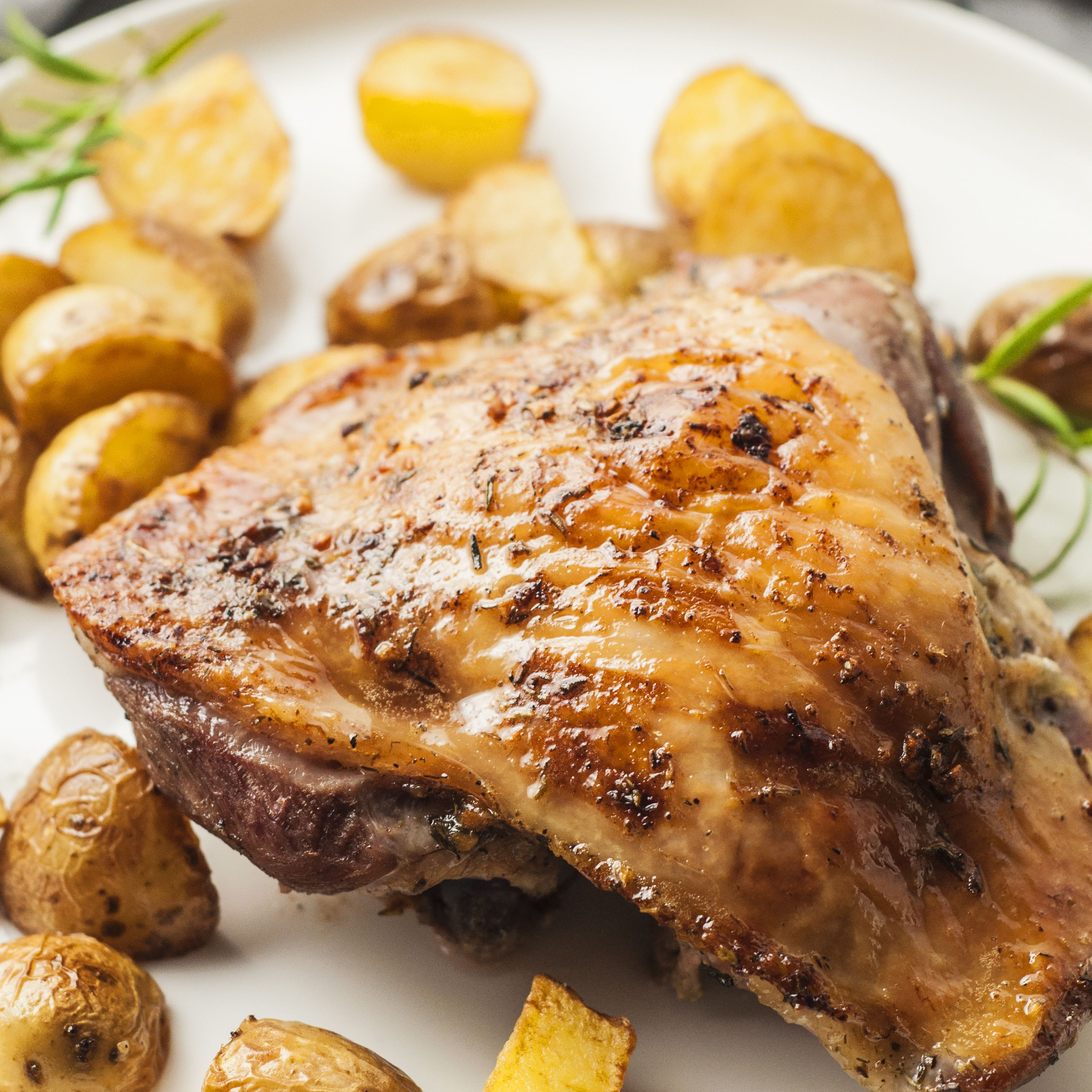 Roasted turkey thighs served with baby potatoes