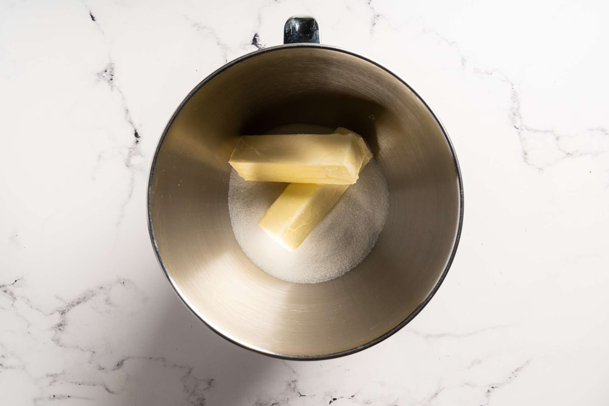 Butter and sugar in a mixing bowl