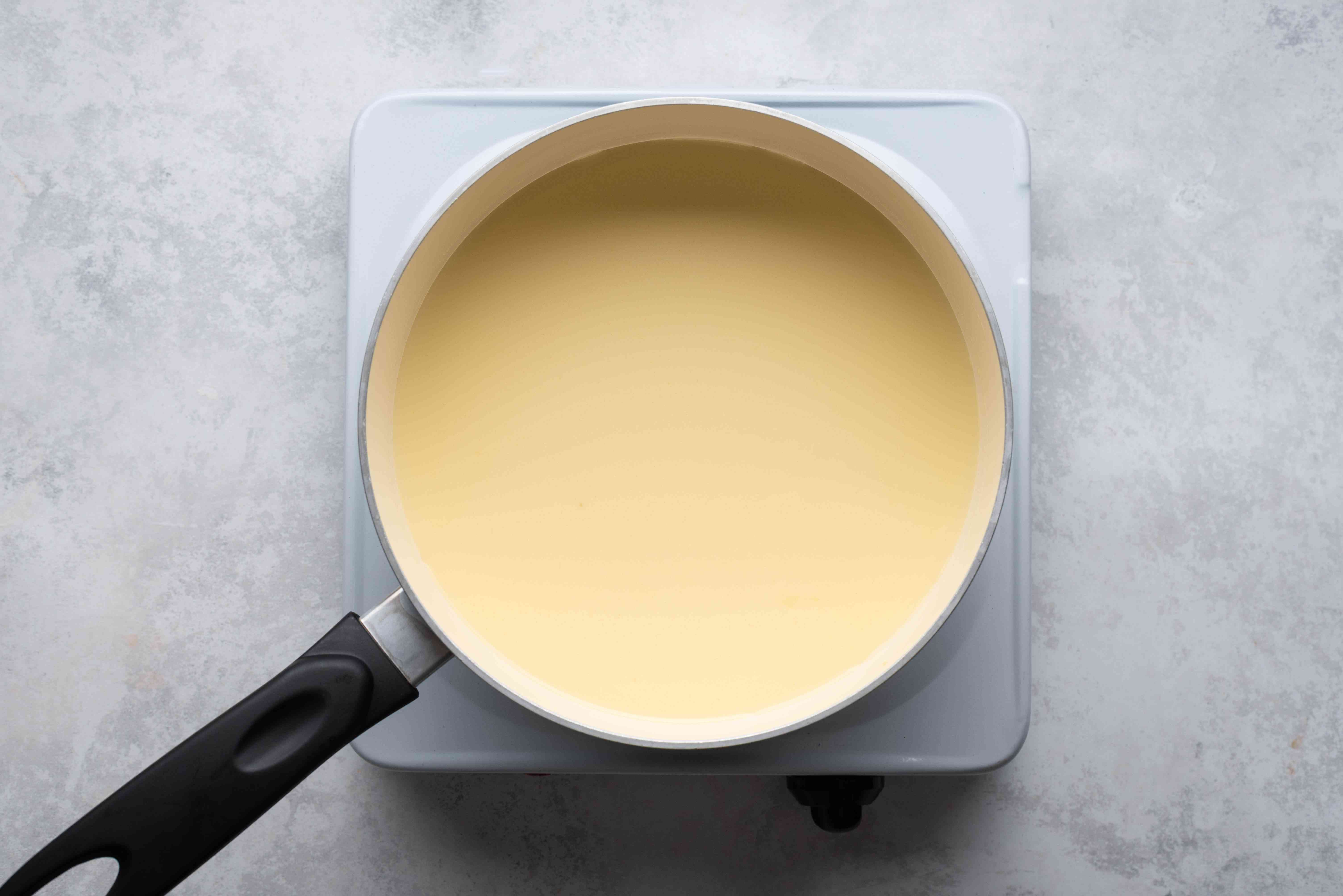 Combine the heavy cream, milk, sugar, and golden syrup in a large, heavy-bottomed saucepan