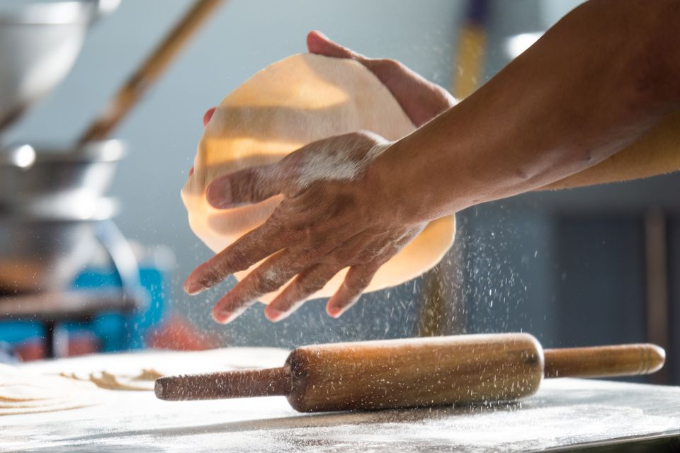 Cropped Hands Of Person Making Chapatti In Kitchen At Home