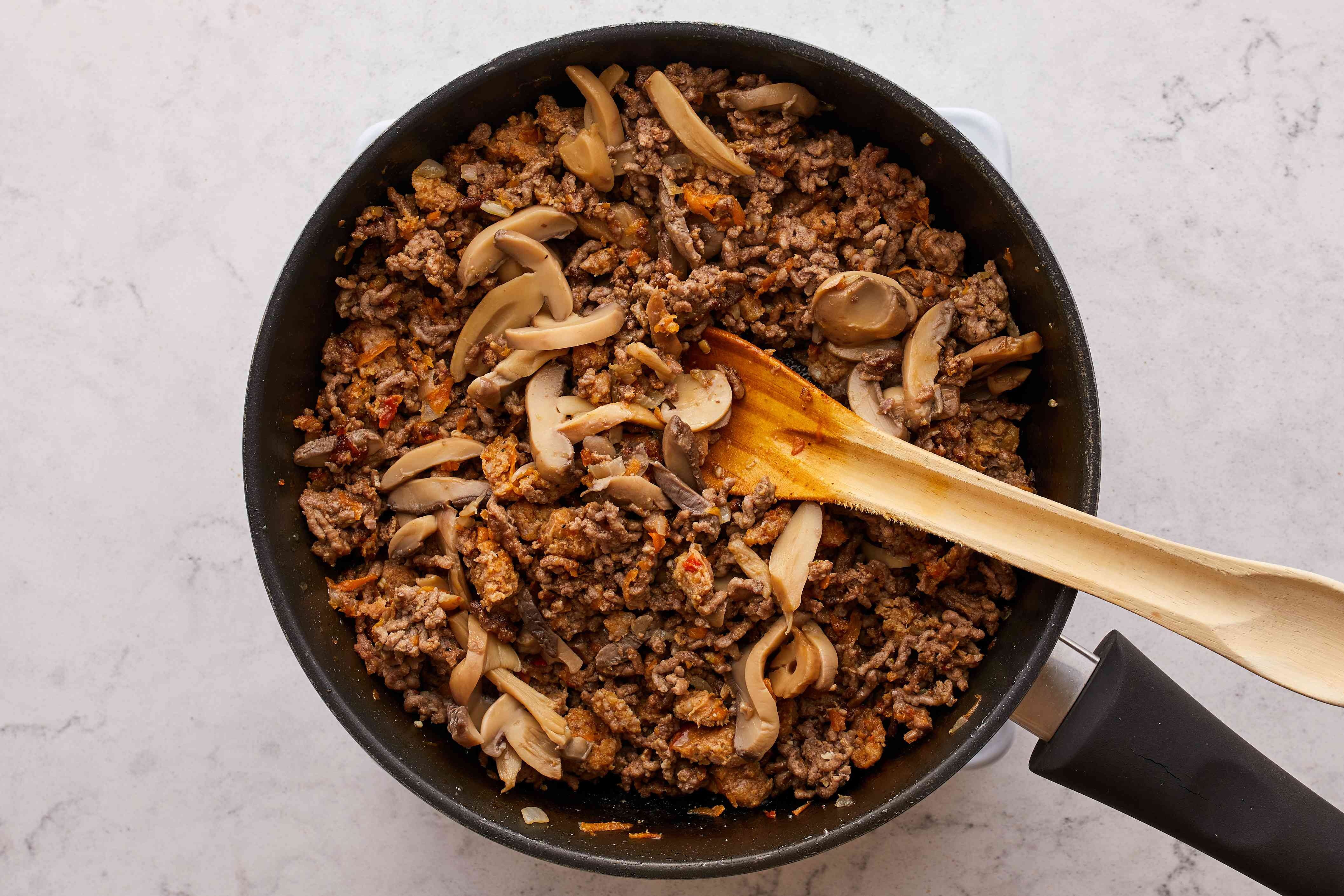add mushrooms to the beef mixture in the pan