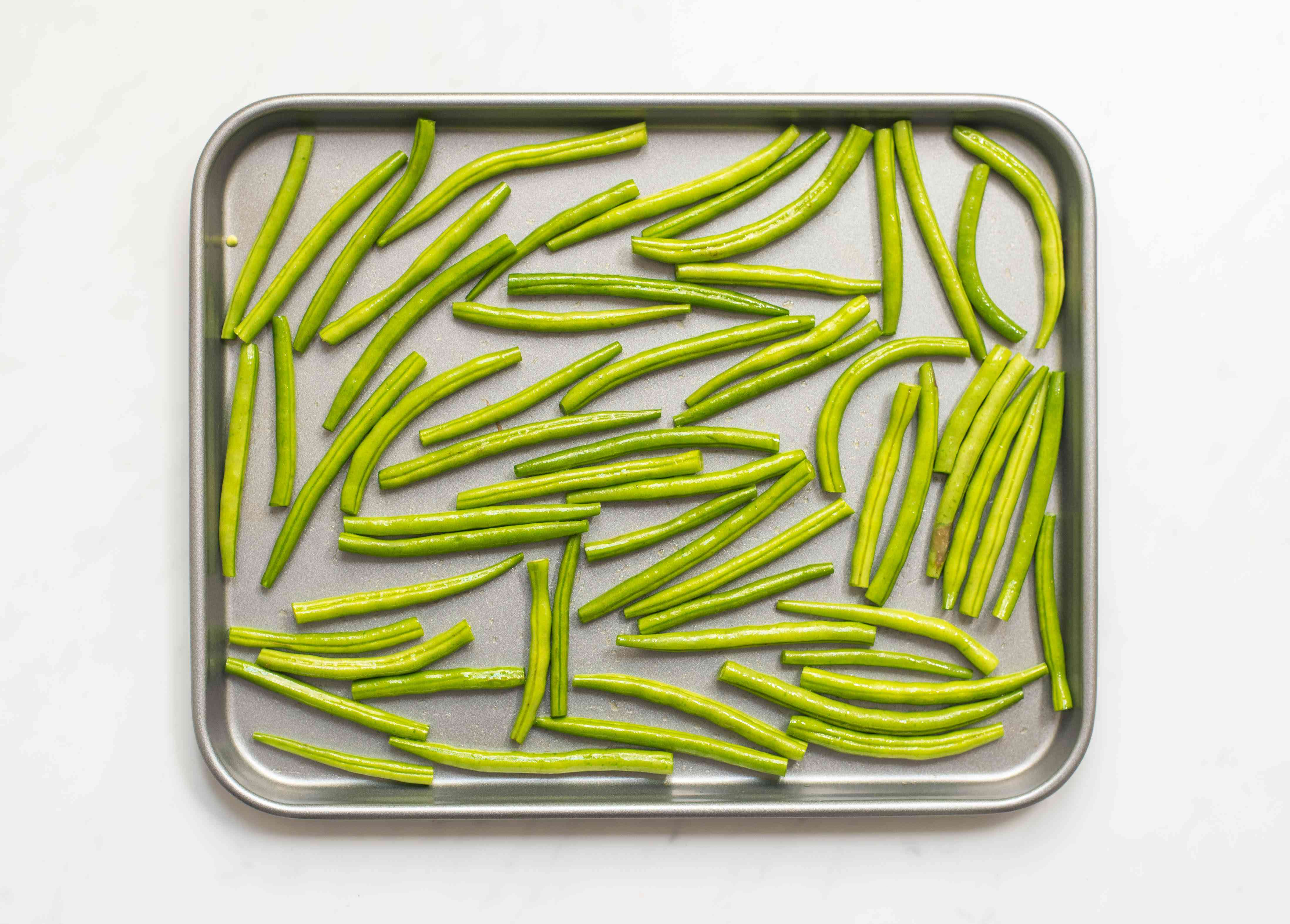 Lift green beans out of bowl