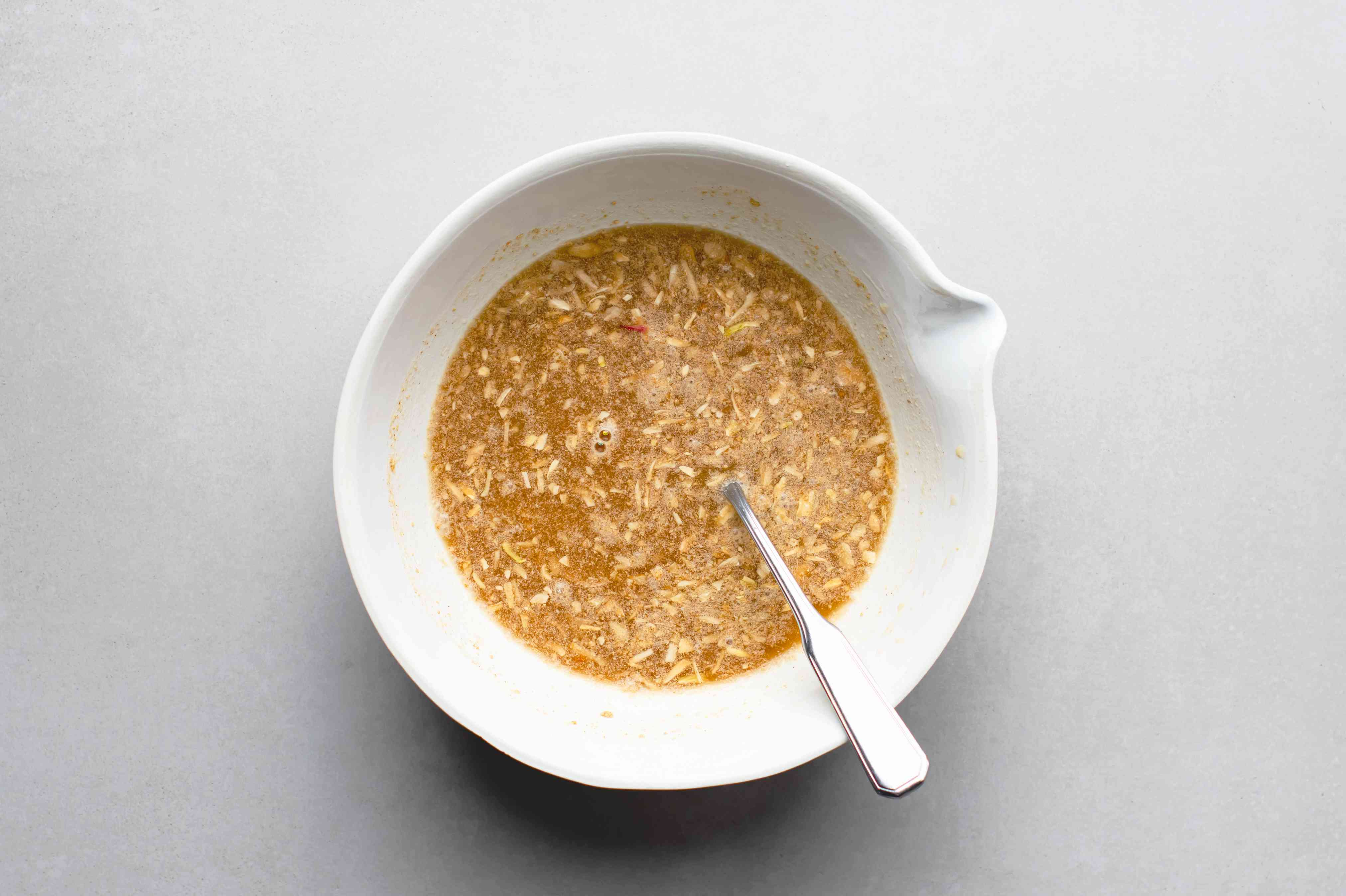 soup mix and chicken broth mixed in a white bowl