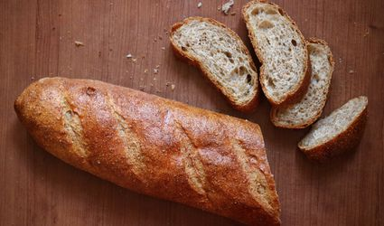A sliced whole wheat baguette