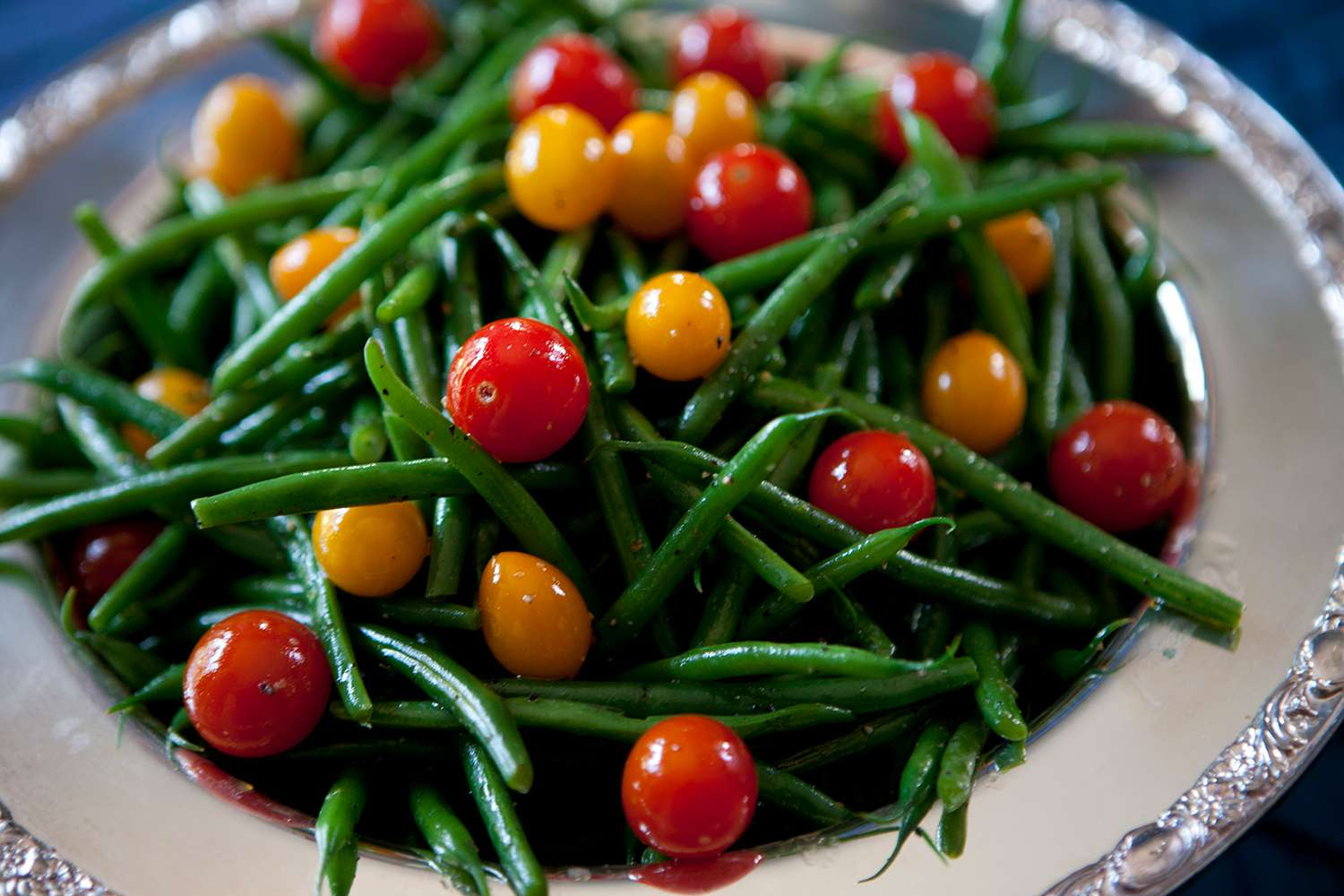 Close up of green beans and tomatoes