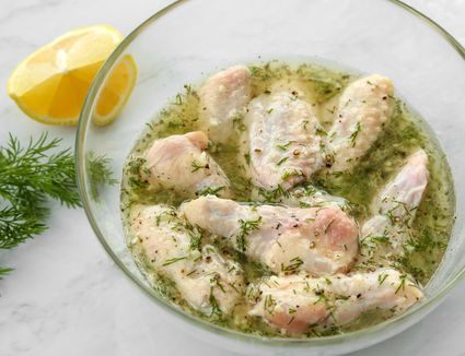 Chicken in a bowl in a lemon pepper marinade