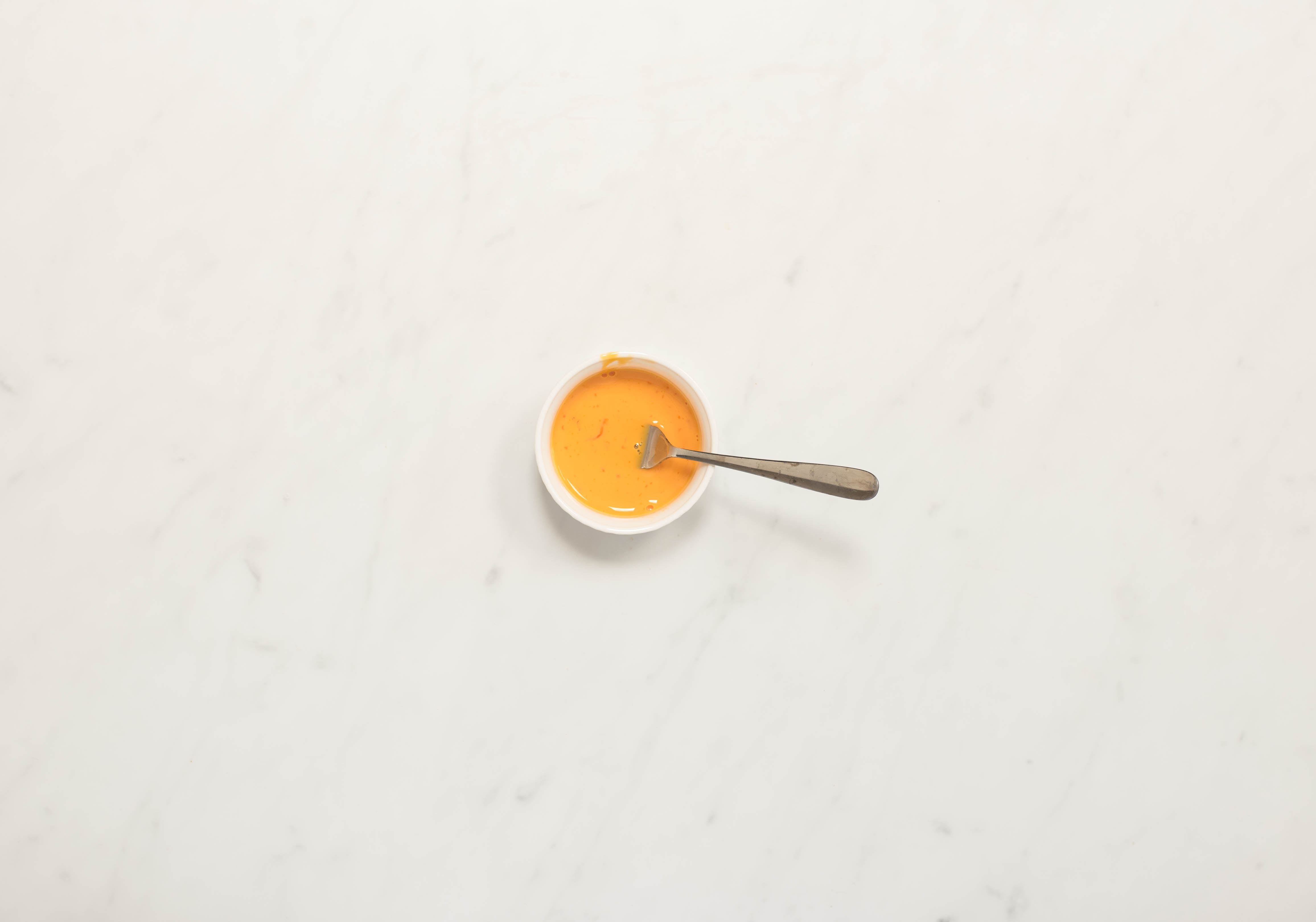 Combine egg yolk and cream