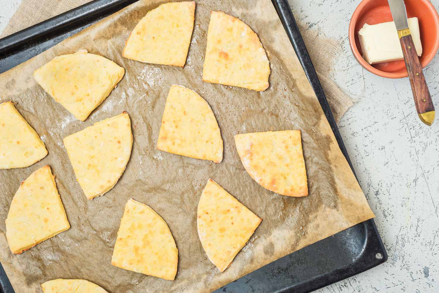 Baked Tattie scones on a baking sheet with parchment
