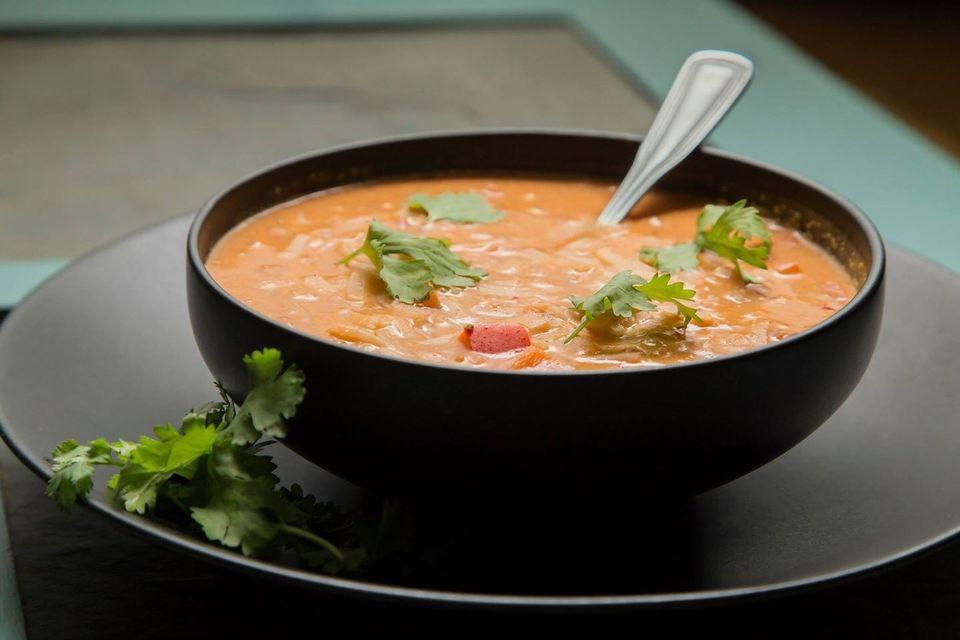 Vegetable Soup In Black Bowl