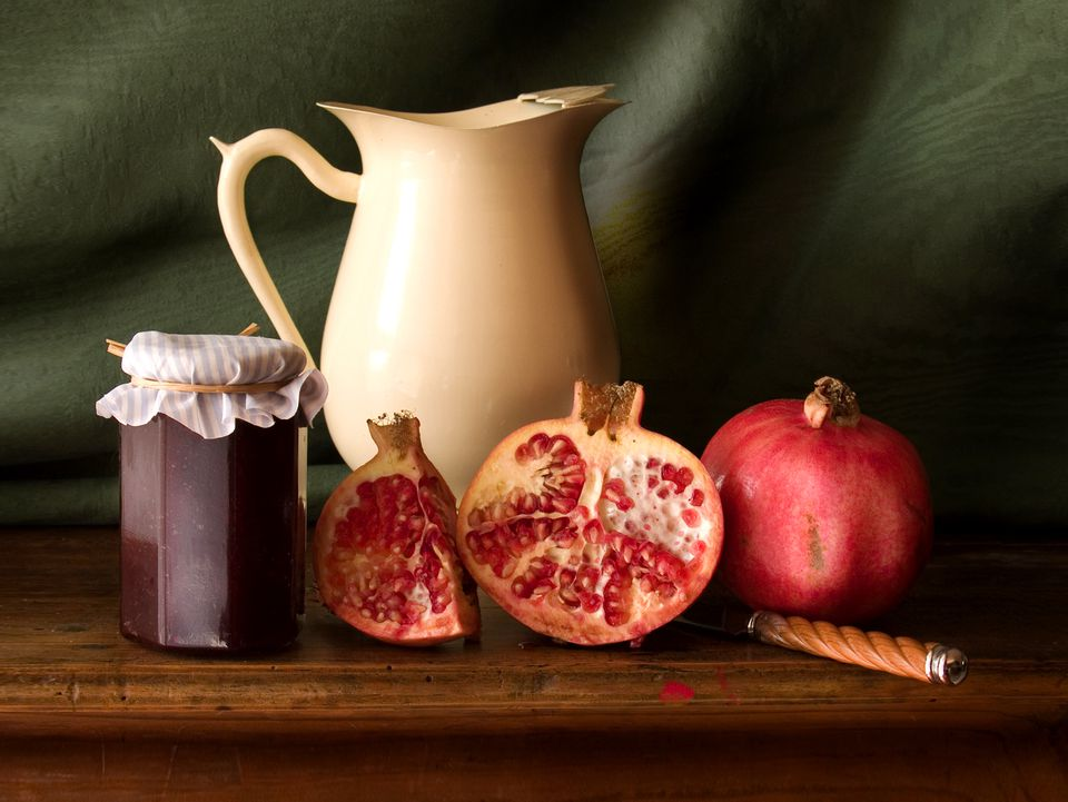 Pomegranates, with jelly and a pitcher