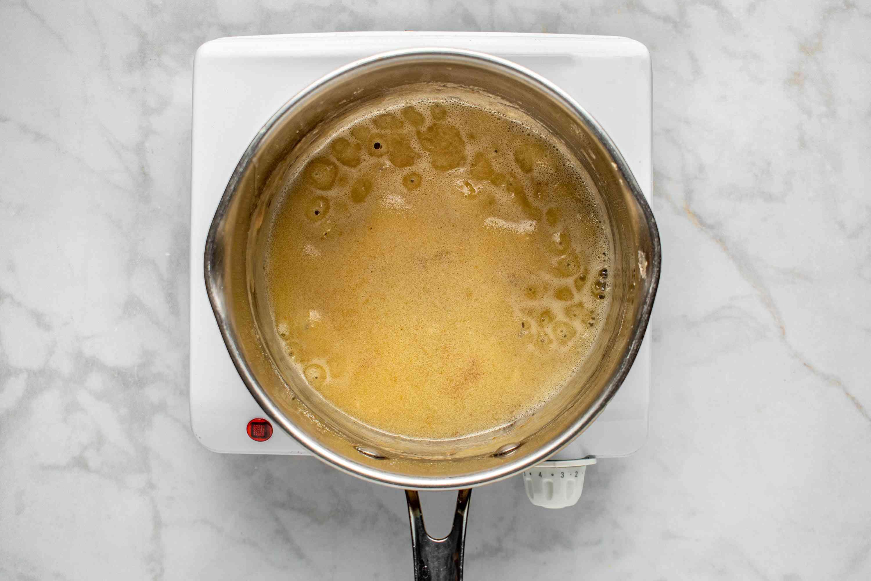 gravy cooking in a saucepan