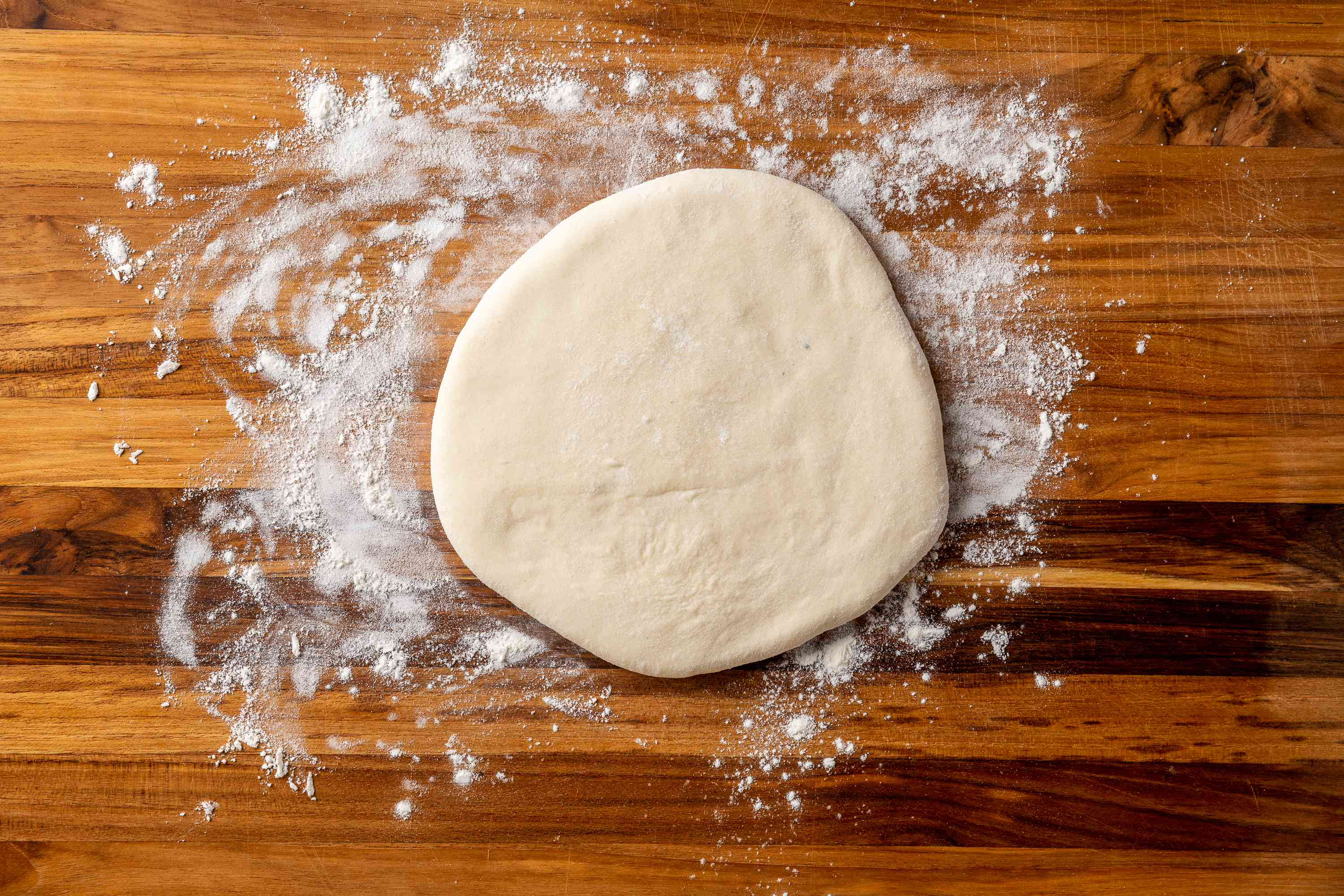 rolled out dough on a floured surface