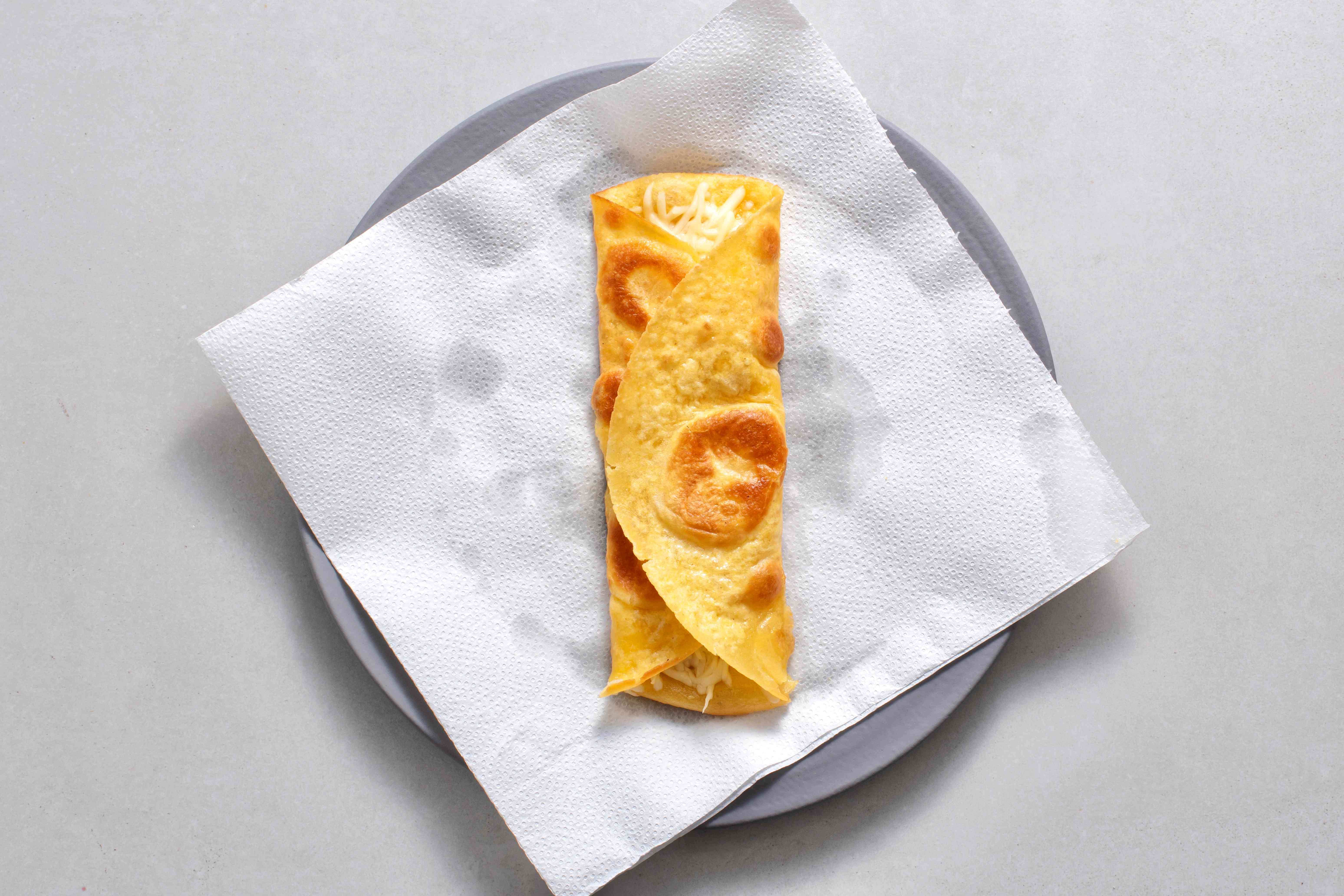 tortilla wrapped around the cheese