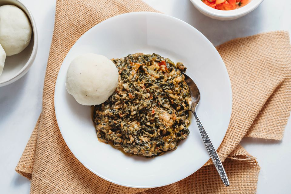Fumbwa Recipe (Congolese Wild Spinach Stew) in a white bowl