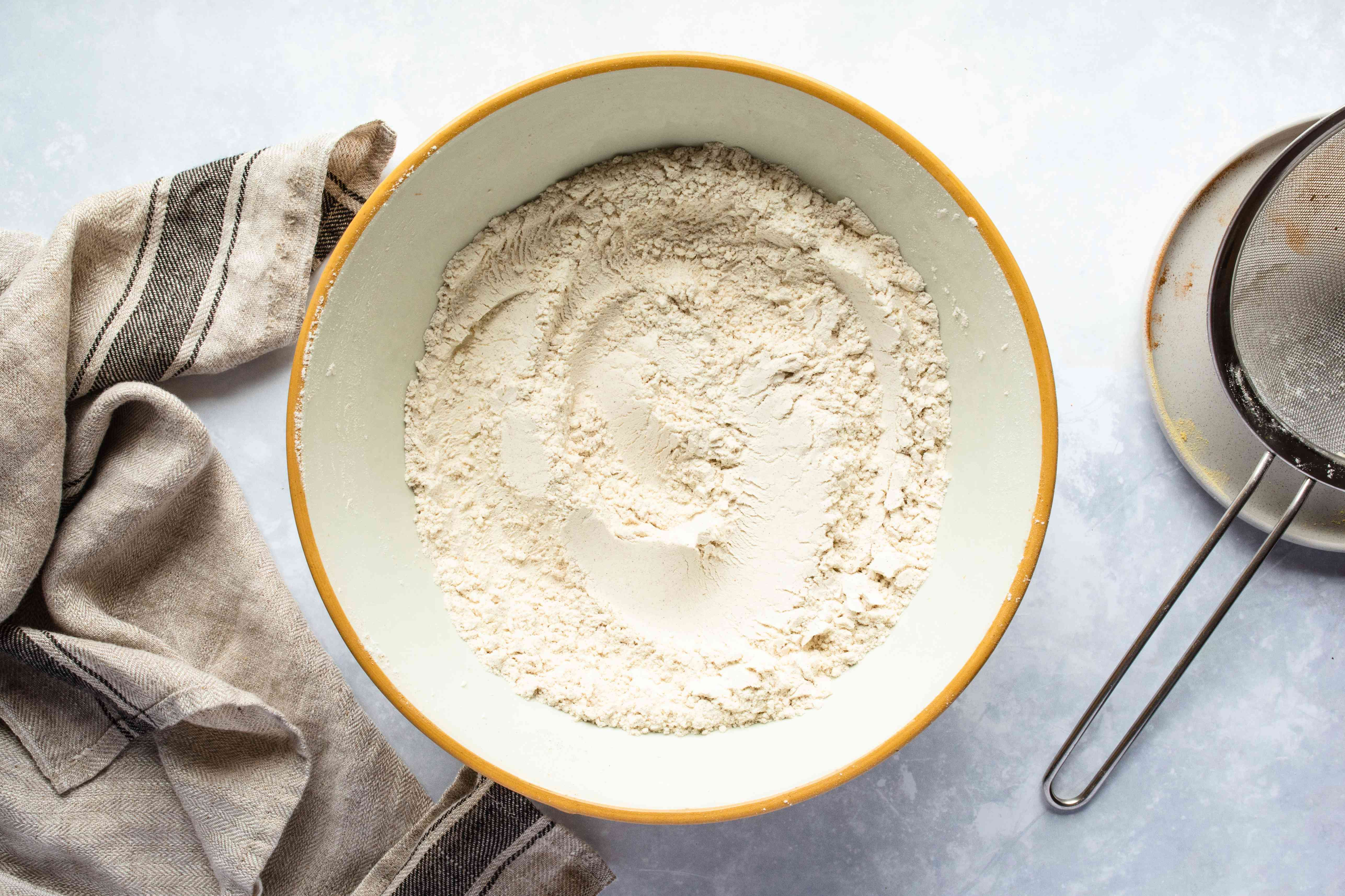 Sift together flour, salt, baking soda