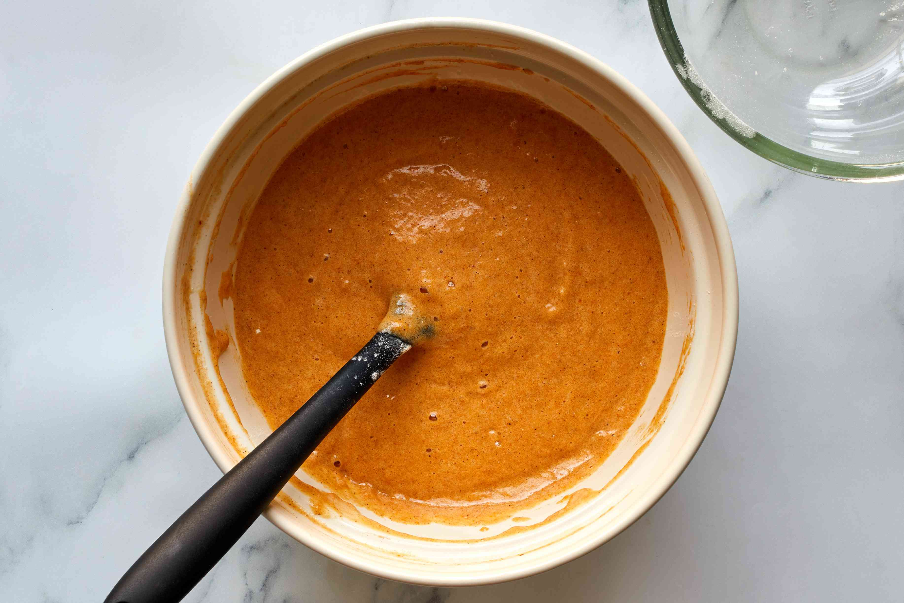 pumpkin cake batter in a bowl