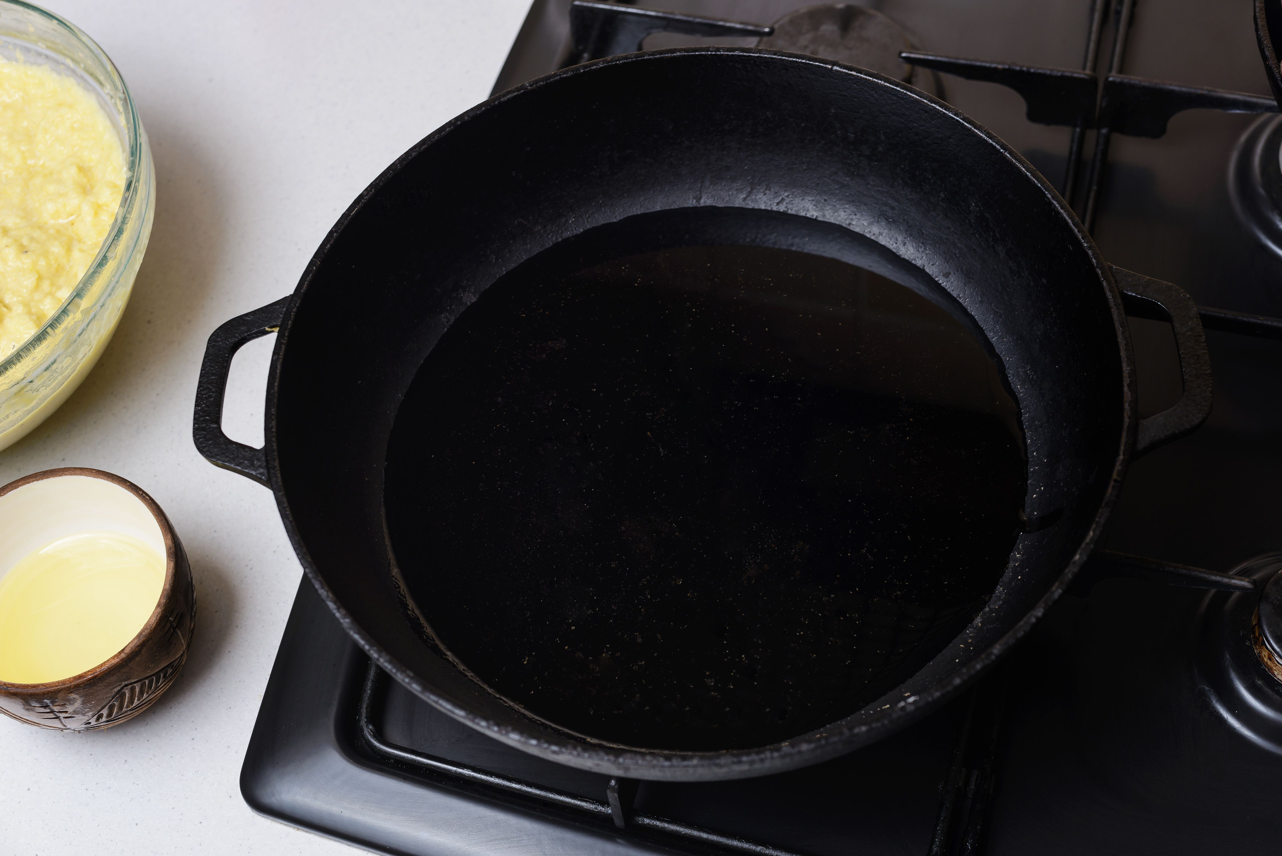 Oil in cast-iron pan on stovetop