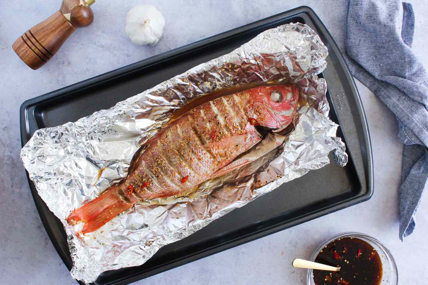 Cooked whole fish on baking sheet