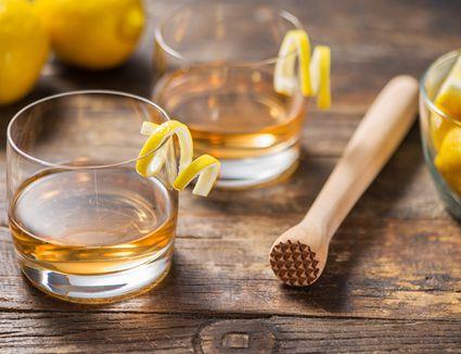 Sazerac cocktail with a lemon twist