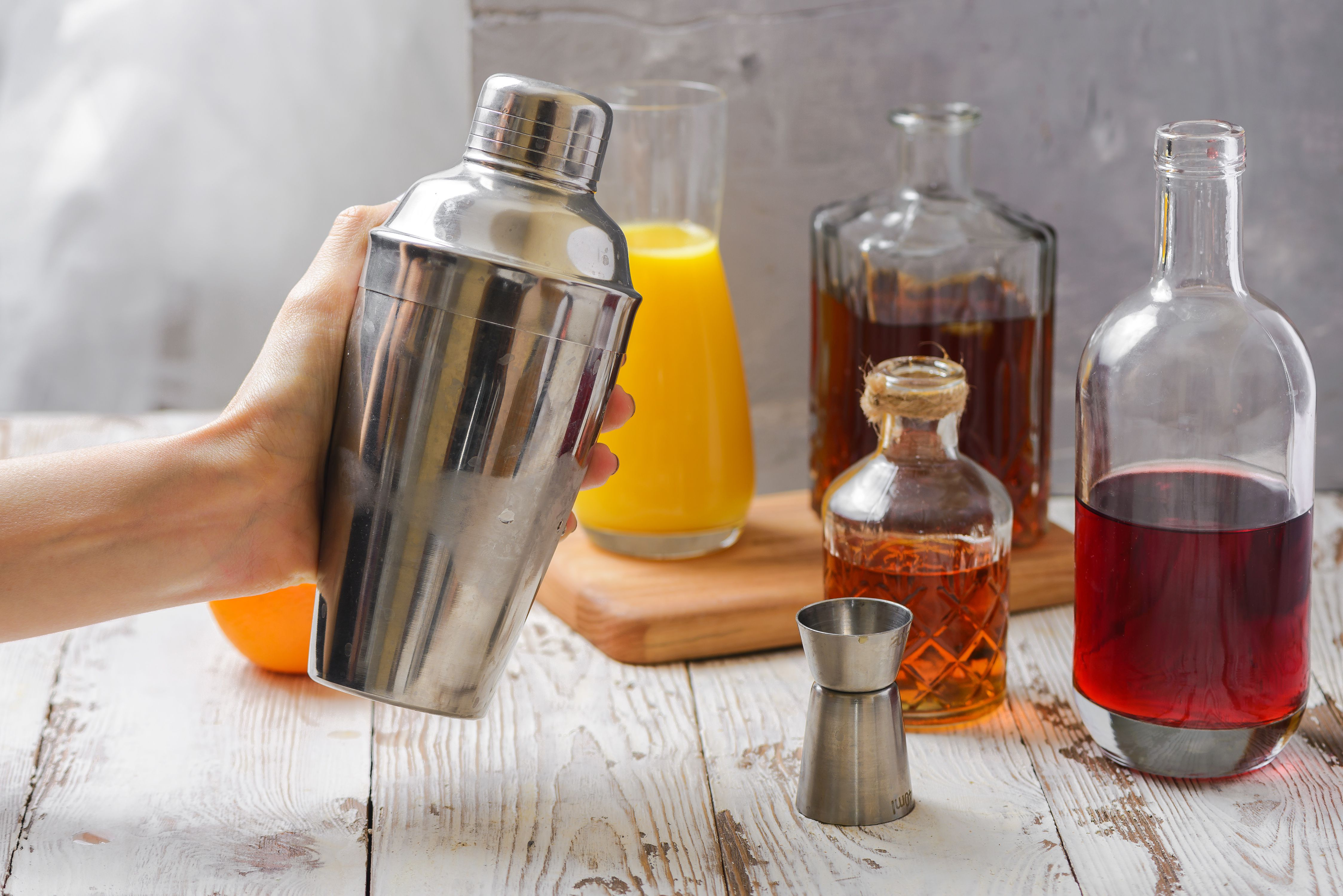 Shaker with Alabama Slammer ingredients
