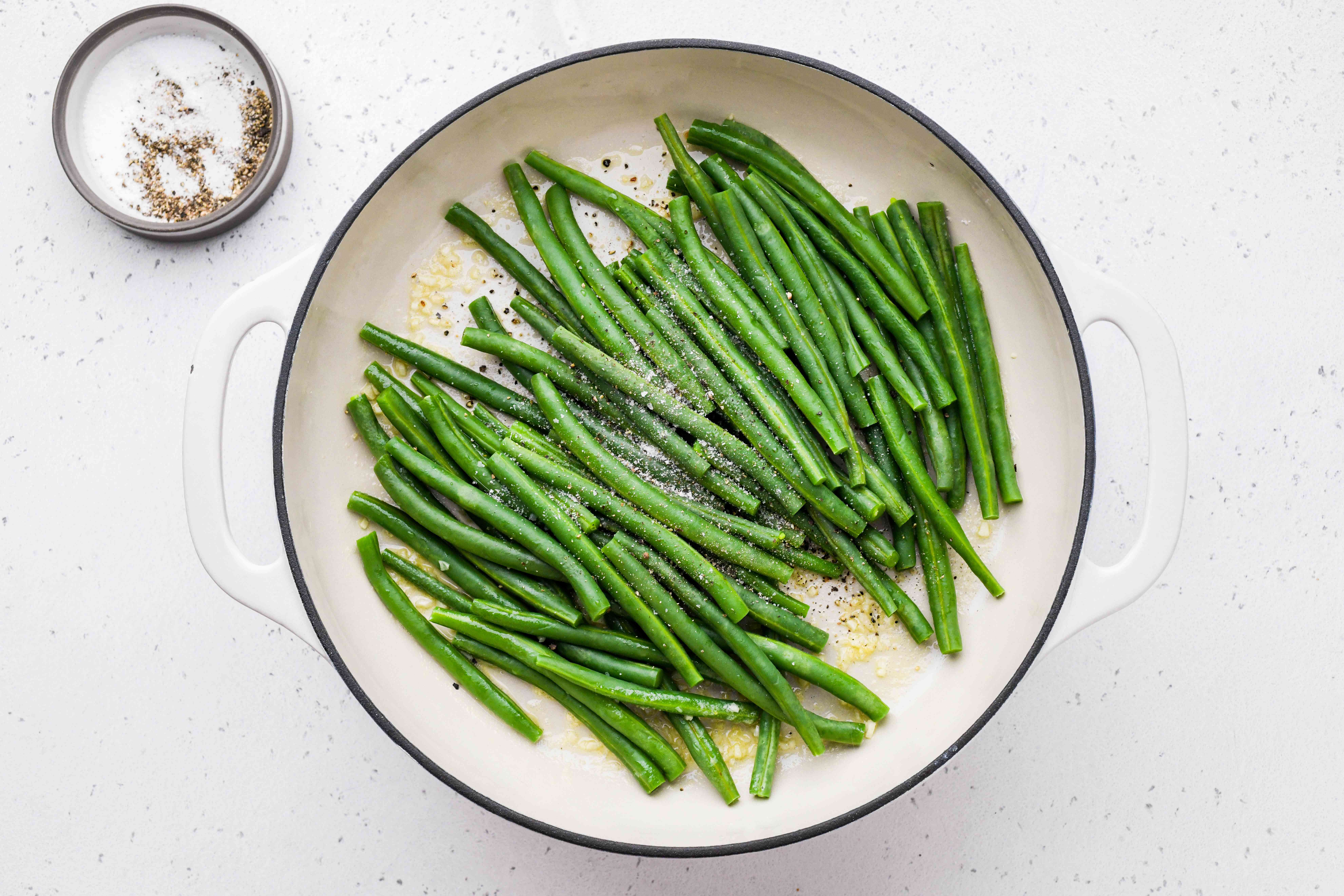 green beans in a pan with butter and garlic