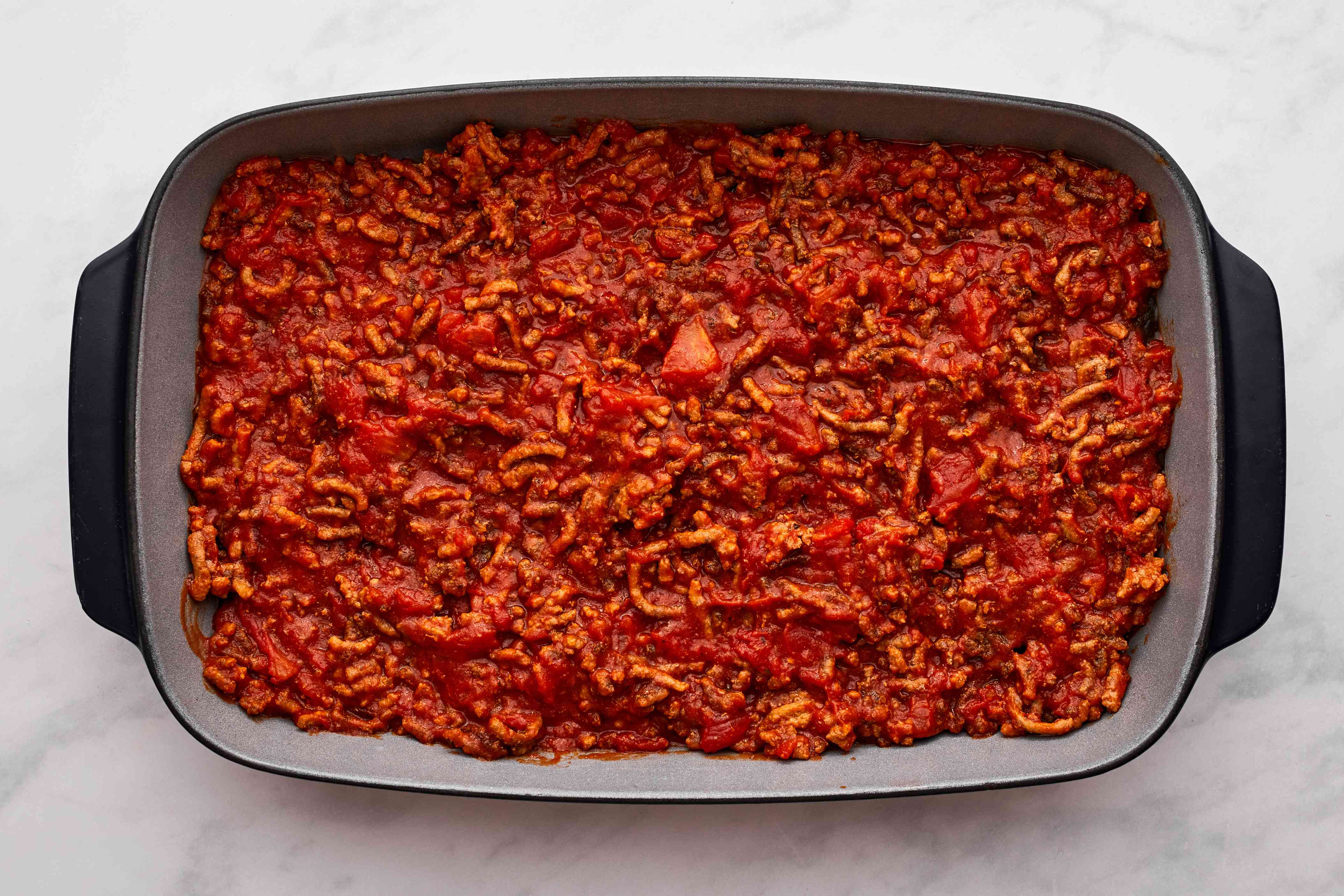 Spread the meat sauce mixture over the eggplant