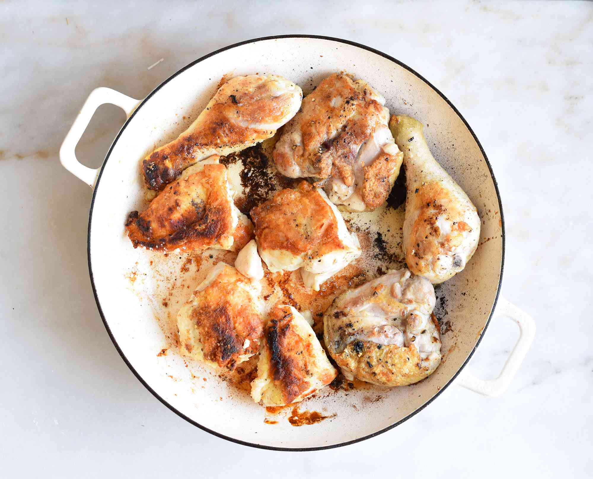 Chicken browned in a pan