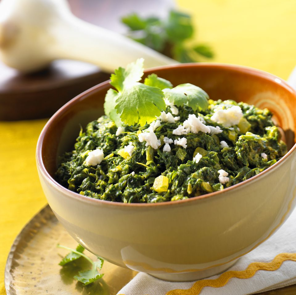 Spinach in a bowl, sprinkled with sheep's cheese (India)