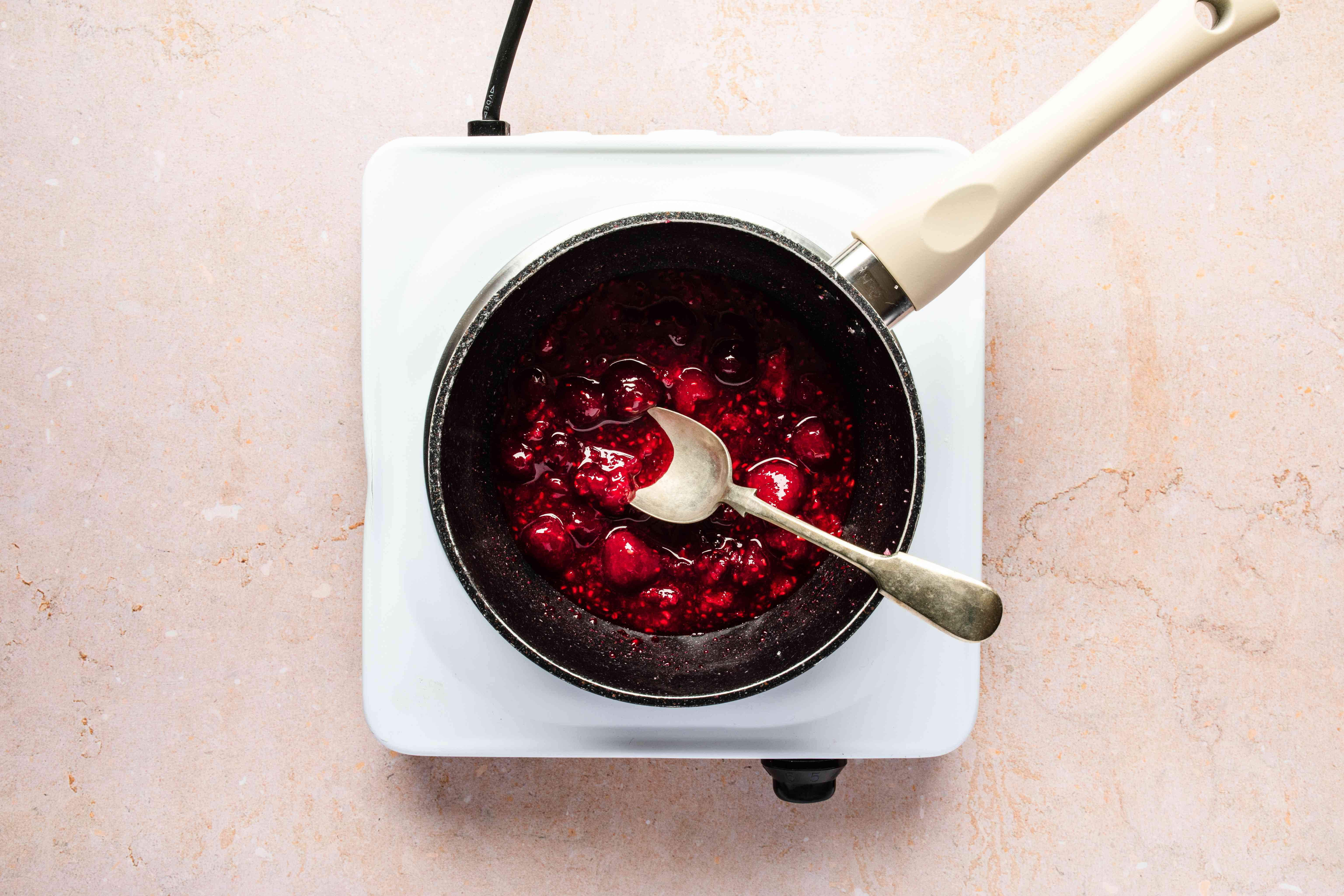 Place raspberries in pot
