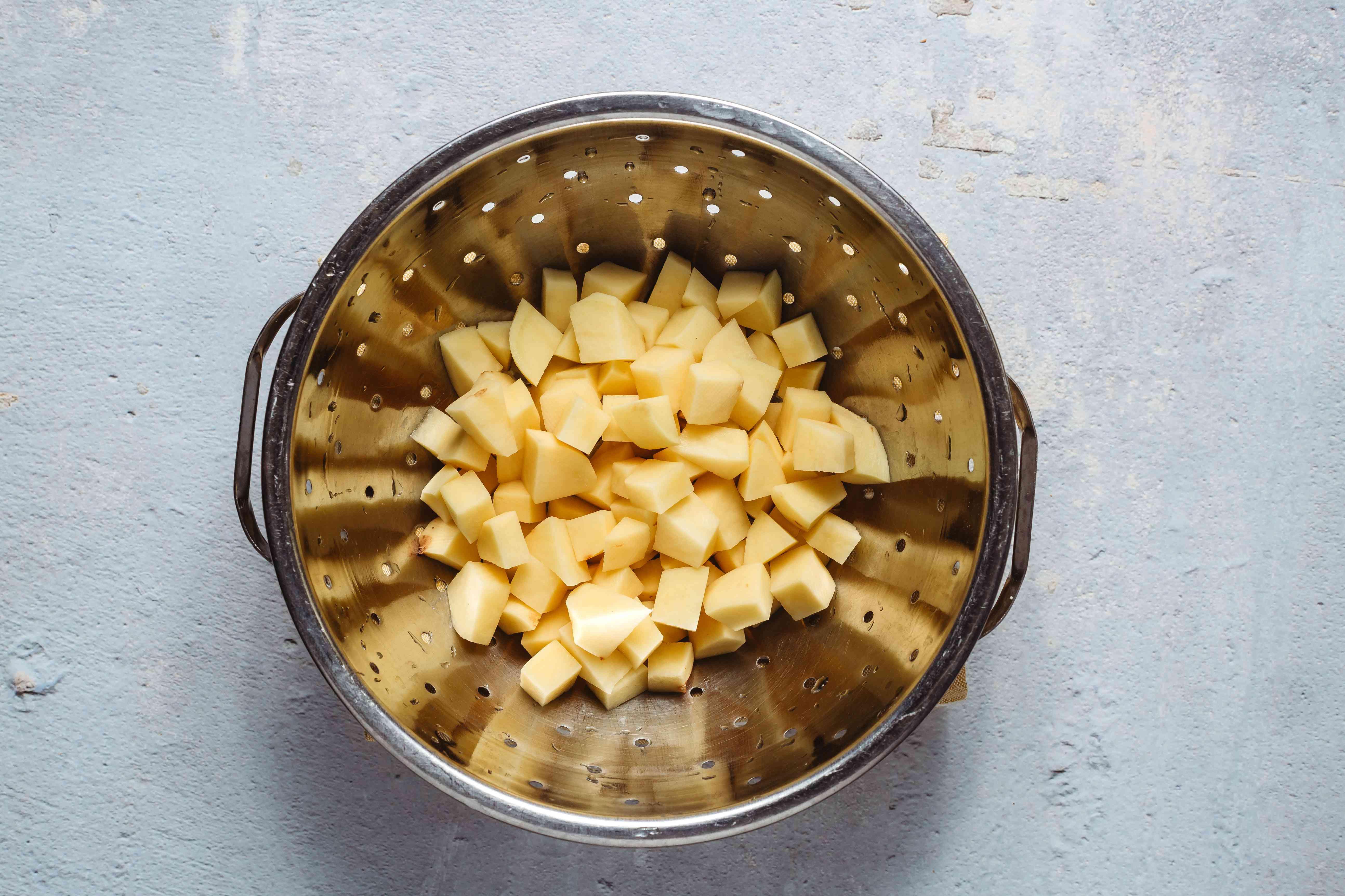 Wash and peel potatoes