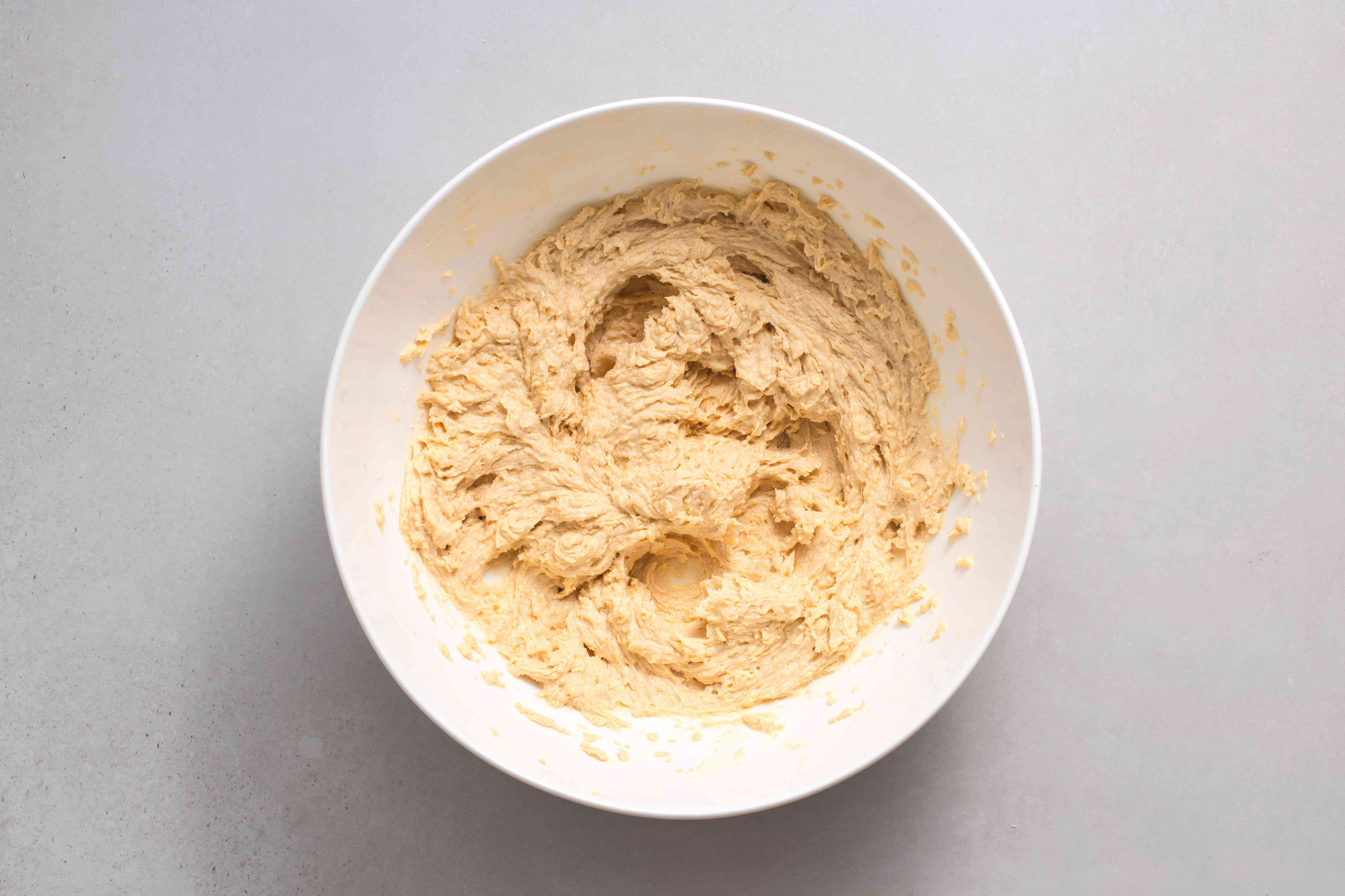 eggs and vanilla added to the cookie batter in the bowl