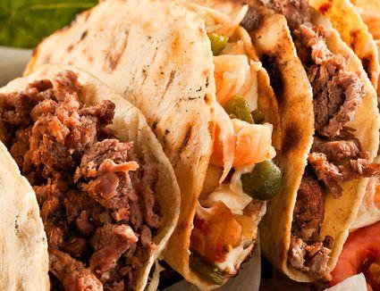 A row of fresh tacos