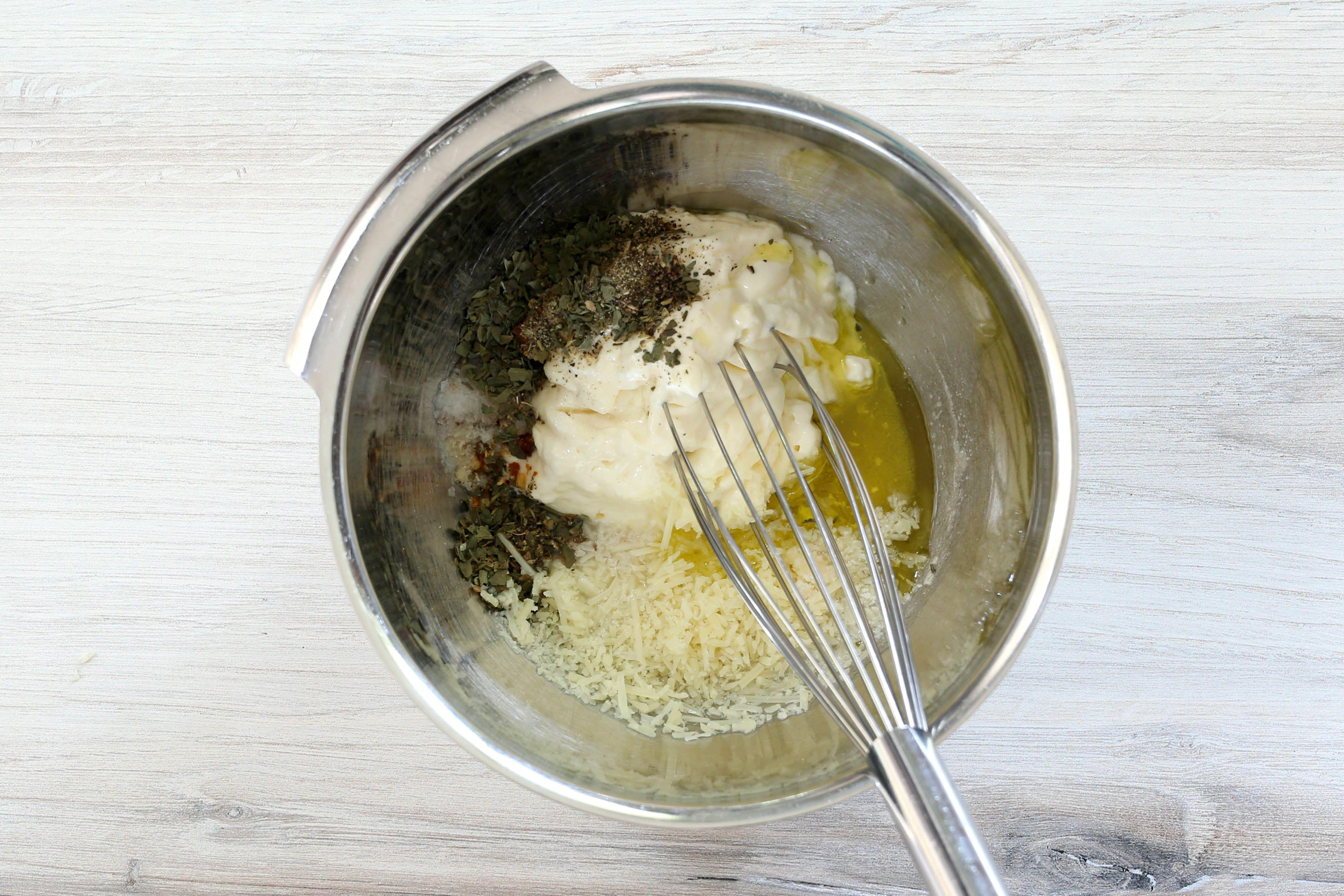 Whisking garlic Parmesan dipping sauce ingredients