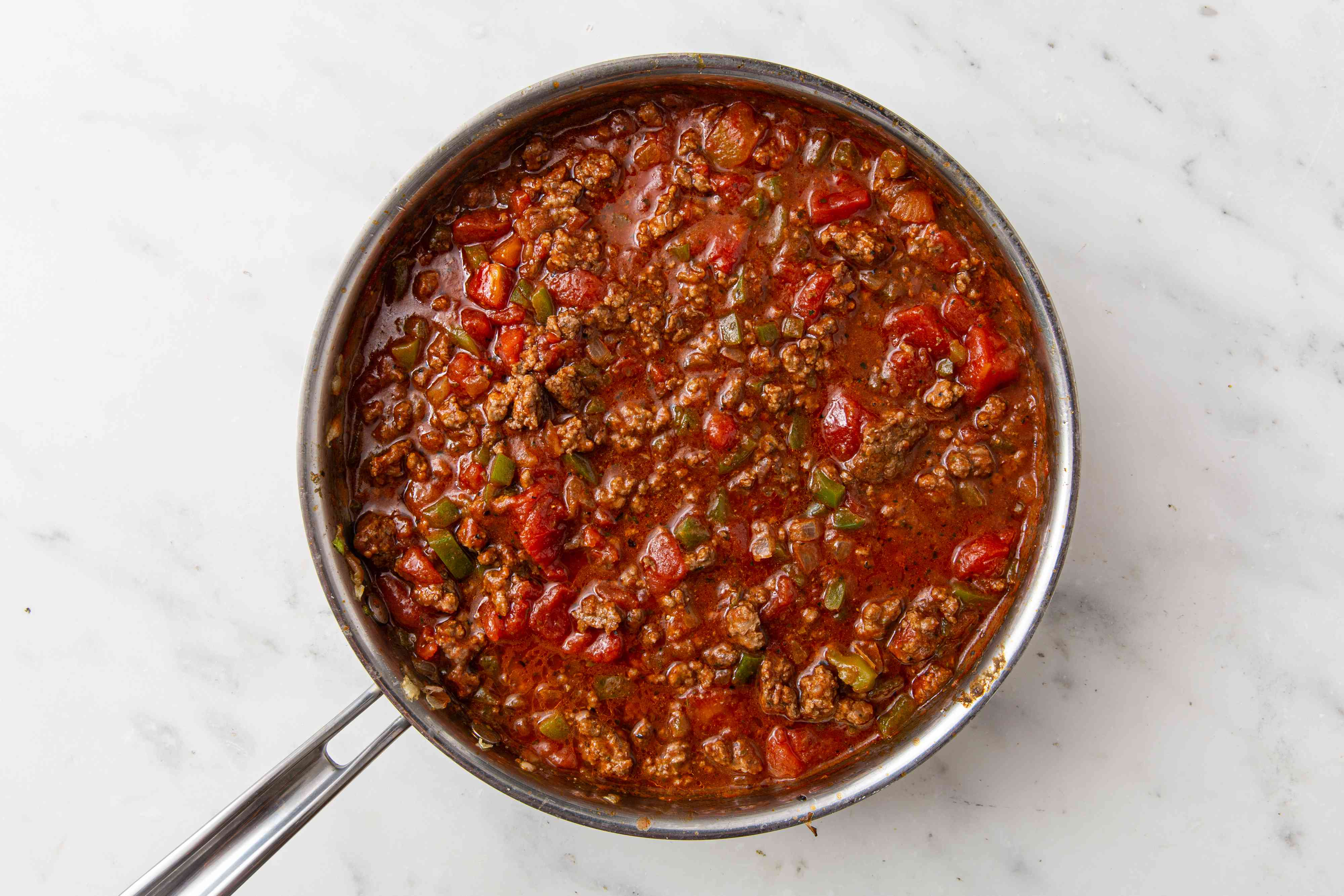 Ground beef, tomatoes, onions and green peppers in a pan